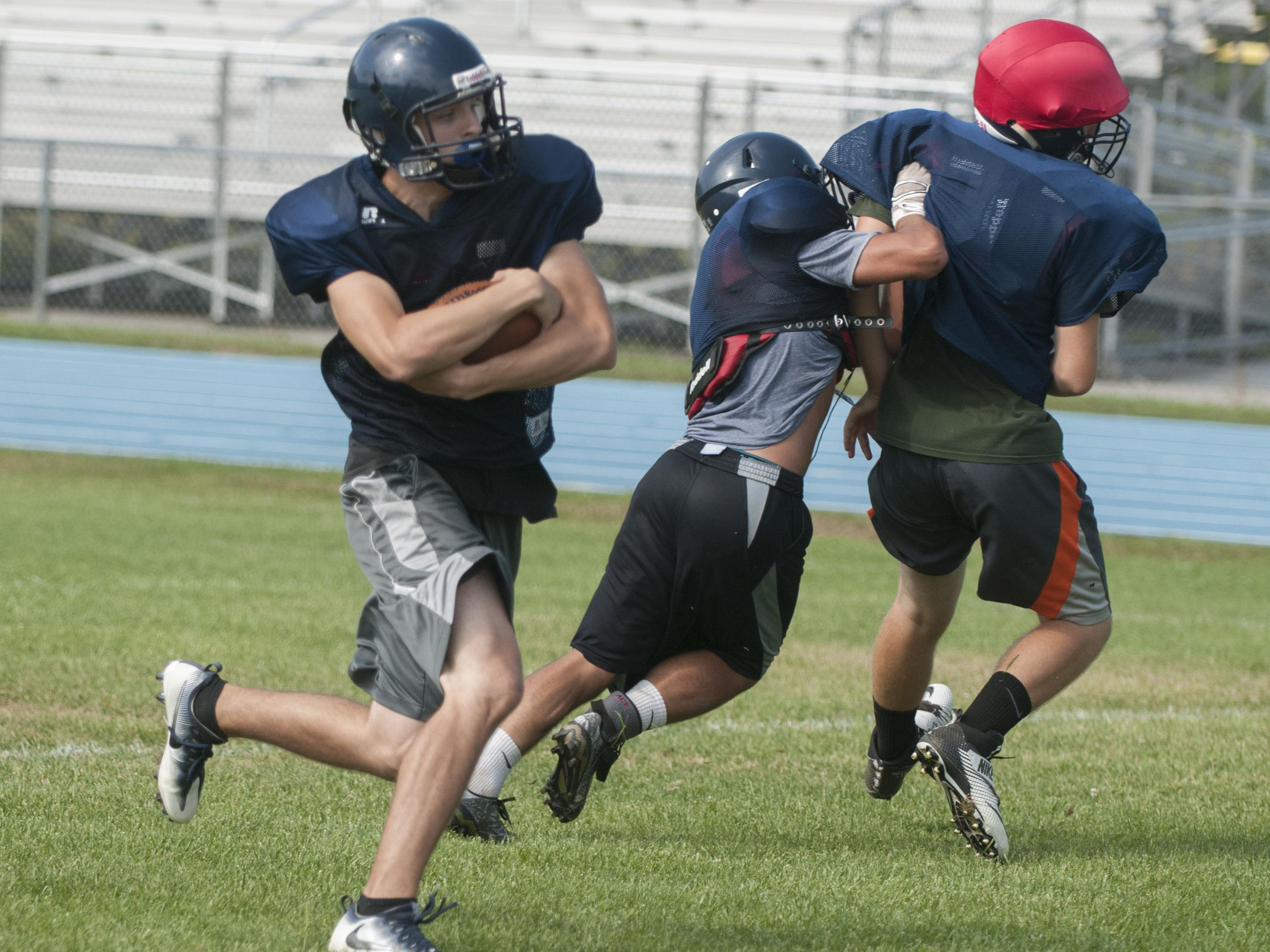 Yale's Andrew Phillips runs the ball Thursday, Aug. 11, 2016 during their football practice at Yale High School.