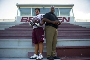 Bearden High School senior Dakota Davis, left, and his dad Antone, former Tennessee All-American offensive tackle, have each other's back at Bearden High School on Wednesday. (Photo: Caitie McMekin/News Sentinel )