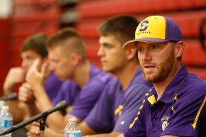 Scottsburg football coach Kyle Mullins speaks at the CJ's high school football media day at Indiana University Southeast.
