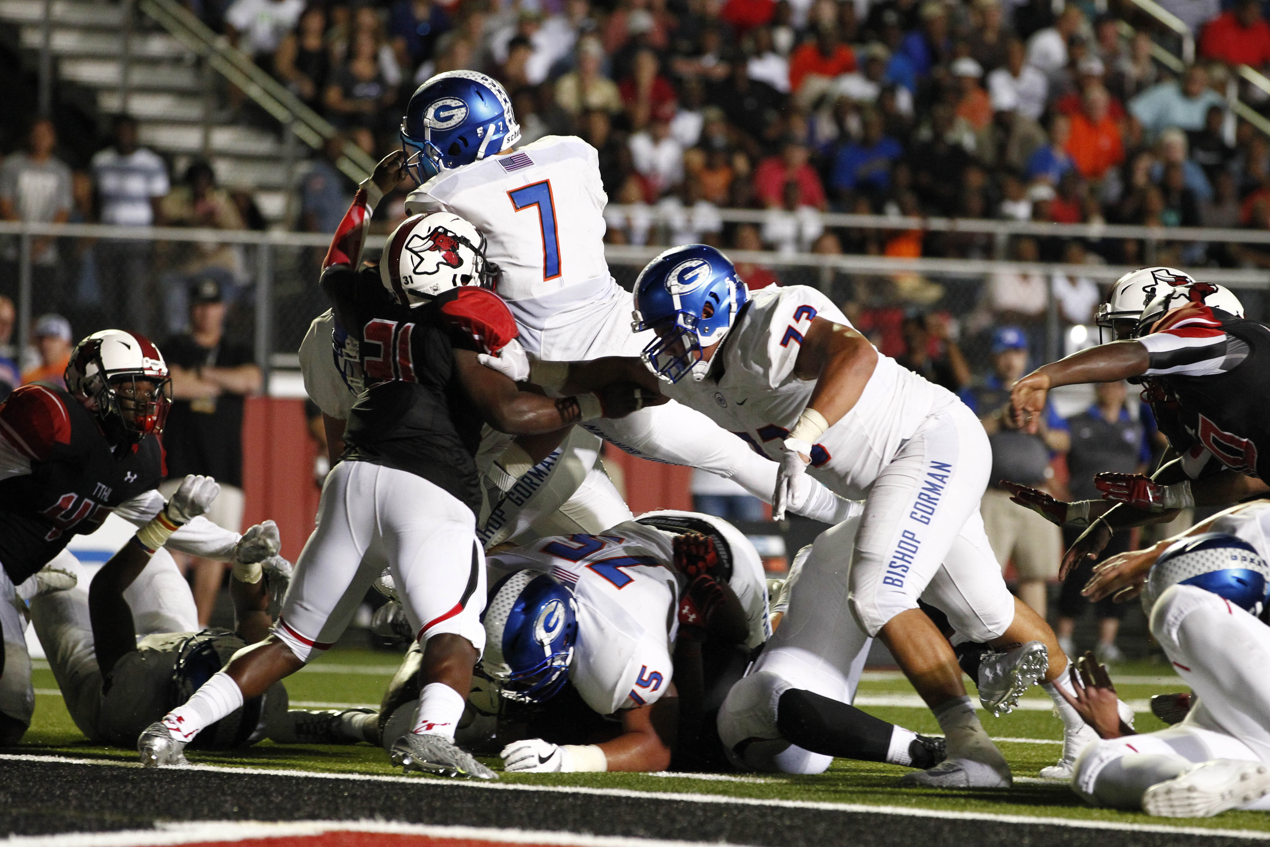 Aug 27, 2016; Cedar Hill, TX, USA; Bishop Gorman Gaels running back Baggio Ali Walsh (7) runs for a touchdown in the second quarter against Cedar Hill Longhorns linebacker Caleb Scott (31) in the second quarter at Longhorn Stadium in Cedar Hill. Mandatory Credit: Tim Heitman-USA TODAY Sports ORG XMIT: USATSI-326116 ORIG FILE ID:  20160827_ajw_sh2_339.jpg