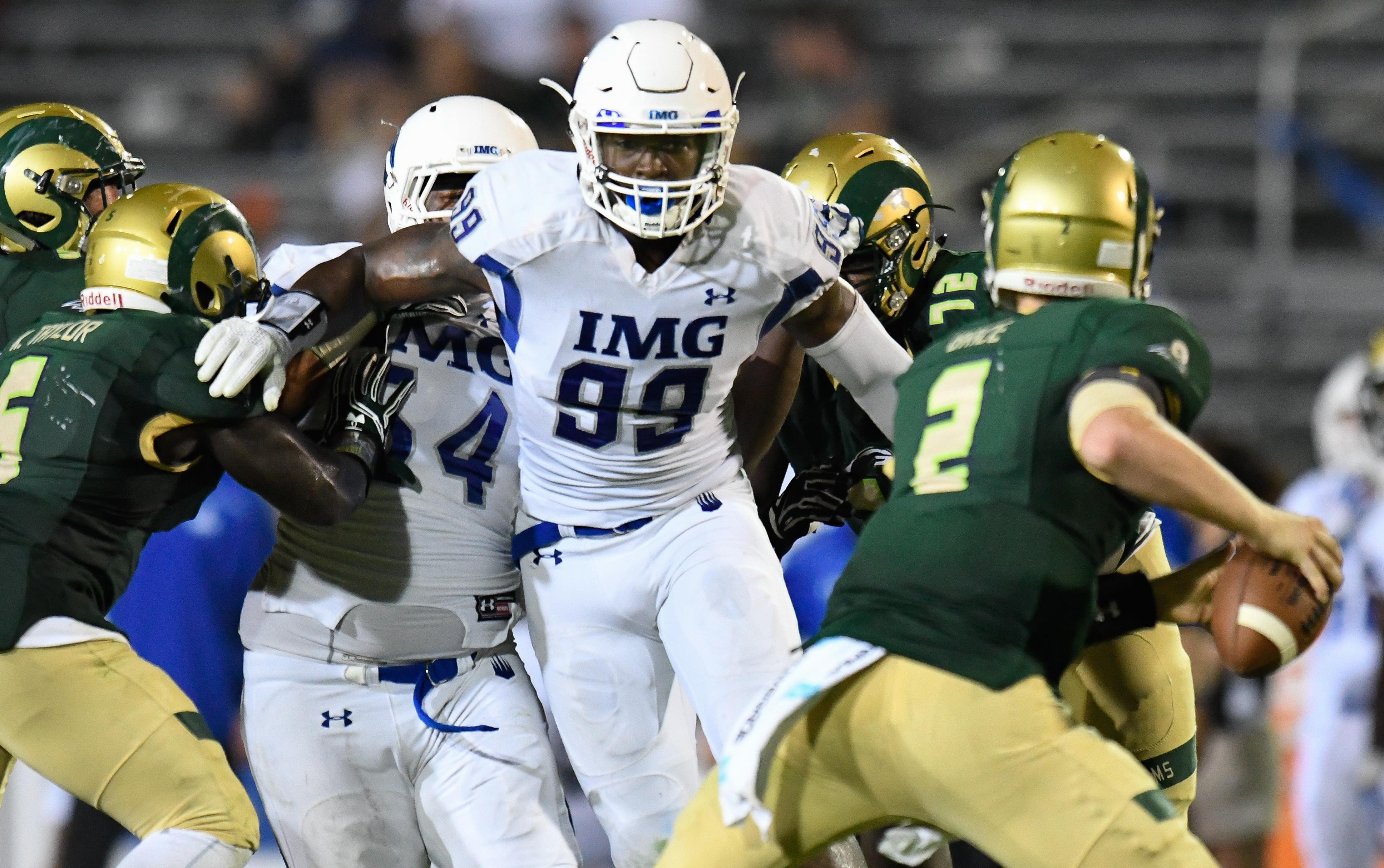 Aug 27, 2016; Loganville, GA, USA; IMG Academy defender Josh Kaindoh (99) rushes the passer against the Grayson Rams during the second half in a high school football duel of top ranked teams at Grayson Community Stadium. IMG Academy defeated the Grayson Rams 26-7. Mandatory Credit: Dale Zanine-USA TODAY Sports ORIG FILE ID: 20160827_sal_sz2_198.JPG