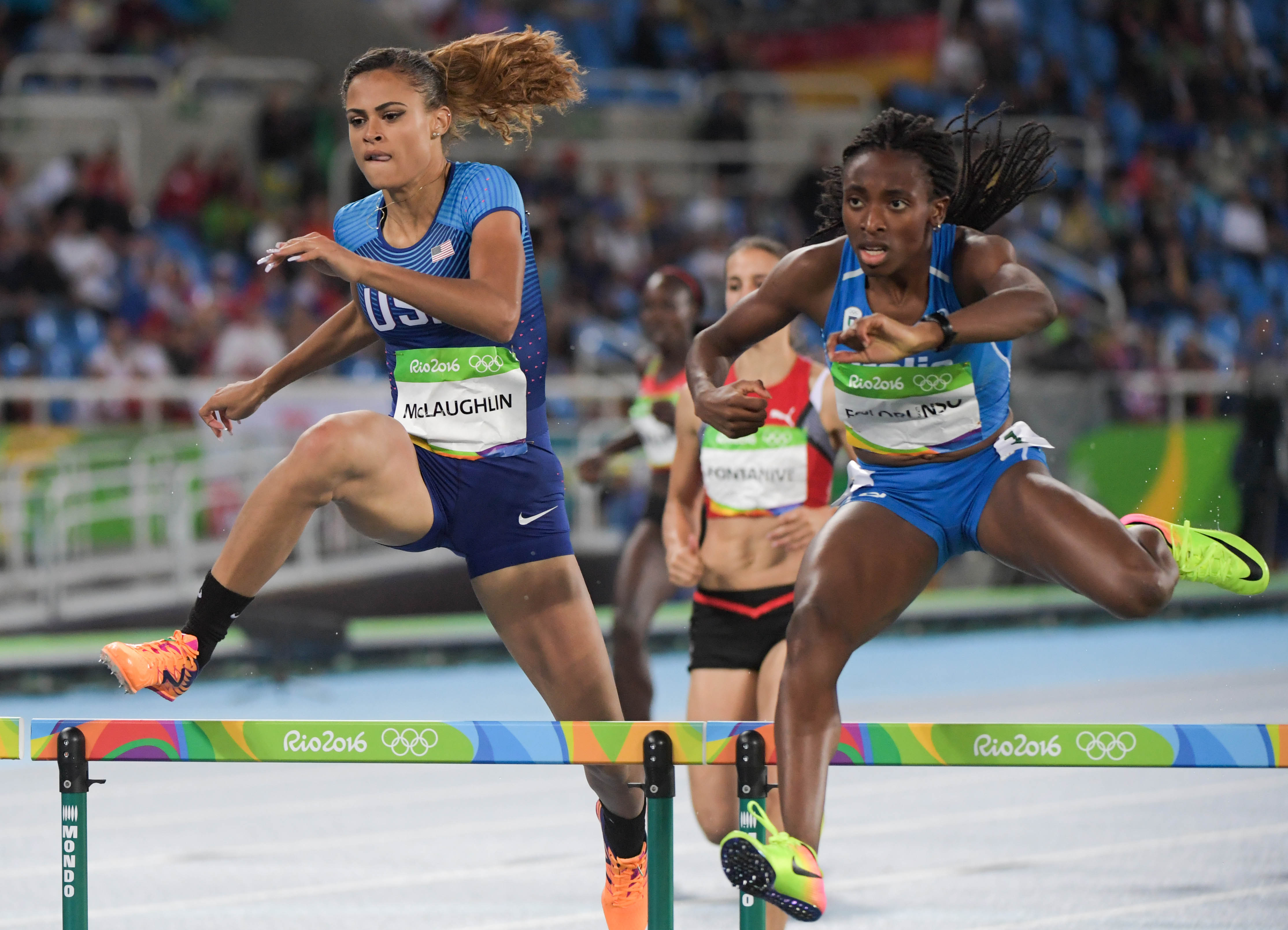 Aug 15, 2016; Rio de Janeiro, Brazil; Sydney McLaughlin (USA) competes in the women's 400m hurdles heat during track and field competition in the Rio 2016 Summer Olympic Games at Estadio Olimpico Joao Havelange. Mandatory Credit: Kirby Lee-USA TODAY Sports ORG XMIT: USATSI-GRP-882 ORIG FILE ID: 20160815_sal_al2_995.JPG