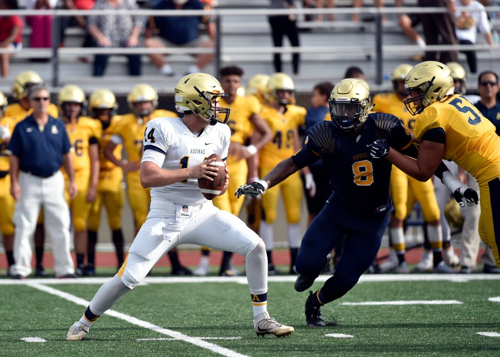 May 19 2016 -- Fort Lauderdale, FL, U.S.A -- St. Thomas Aquinas quarterback Jake Allen (14) throws a pass. St. Thomas Aquinas, the likely No. 1 team in the preseason Super 25, is hosting its annual gold and blue inter squad scrimmage at the school's stadium. -- Photo by Steve Mitchell USA TODAY Sports Images, Gannett ORG XMIT: US 134928 St. Thomas Aquin 5/19/2016 [Via MerlinFTP Drop]