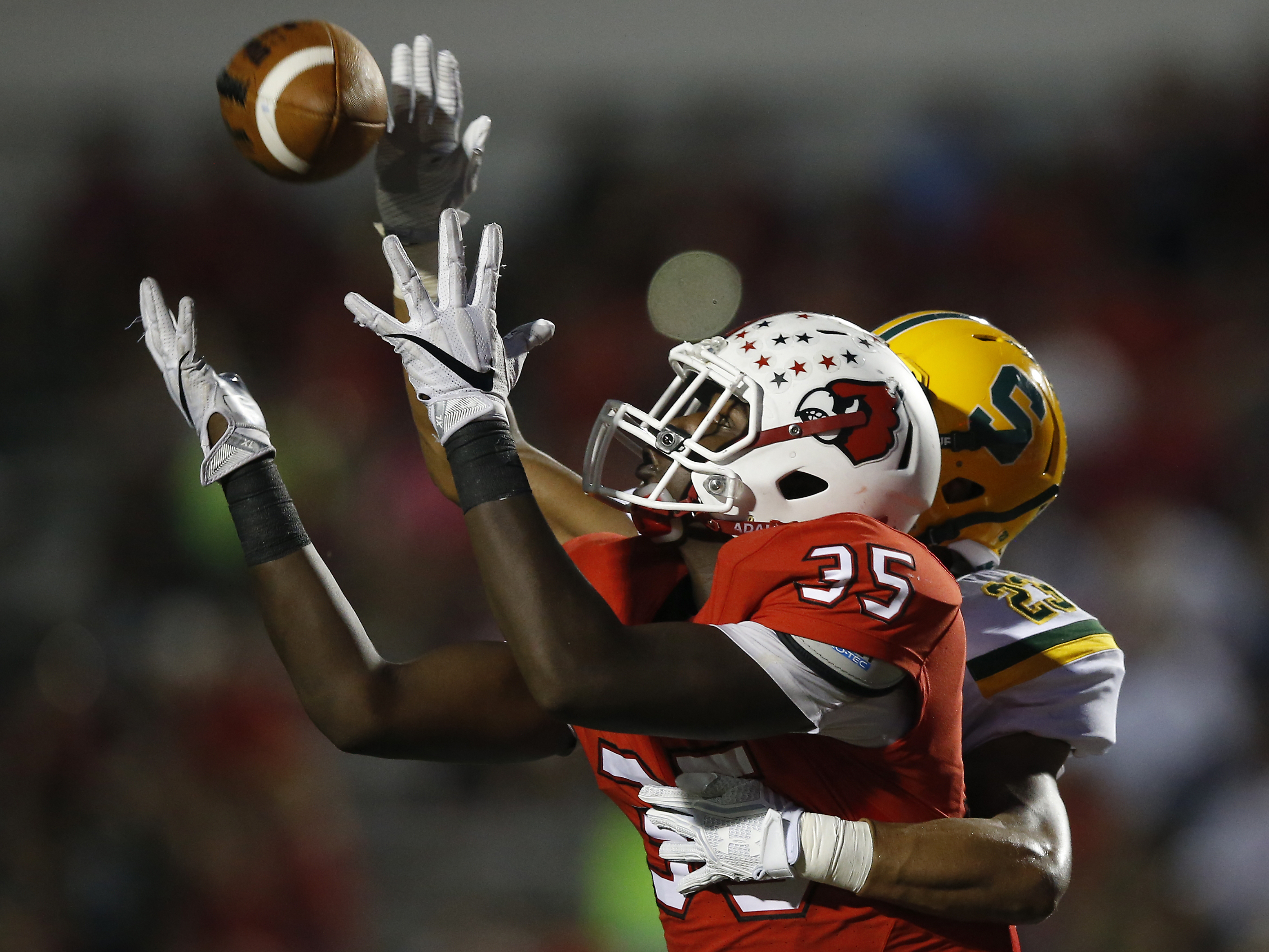Colerain Cardinals' Eric Phillips (35) makes a touchdown catch in the first half during the high school football game between the Sycamore Aviators and Colerain Cardinals, Thursday, Sept. 22, 2016, at Colerain High School in Colerain Township.