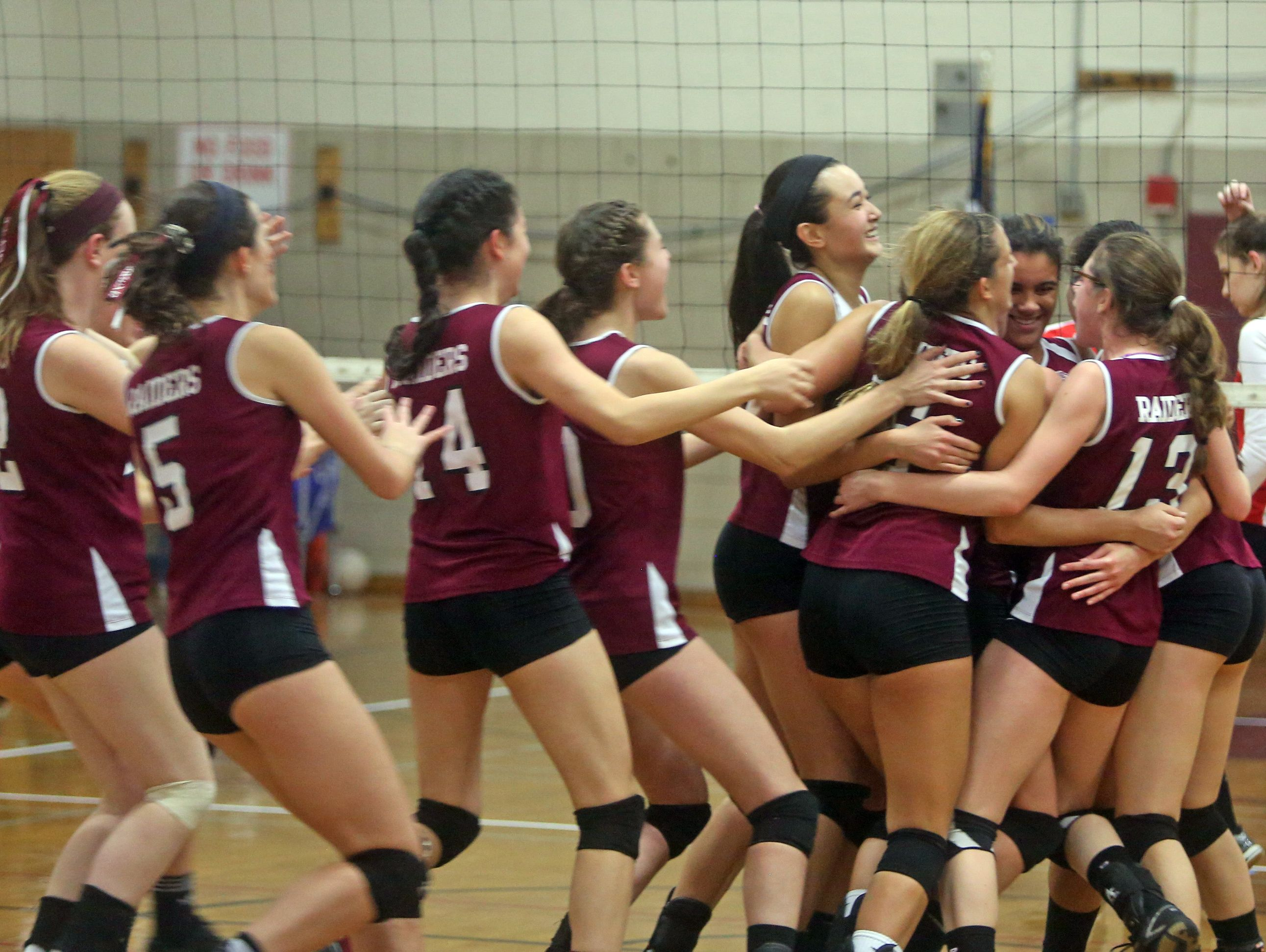 Scarsdale celebrates after defeating Fox Lane in five games in the Class AA volleyball semifinal at Scarsdale High School Nov. 5, 2015.