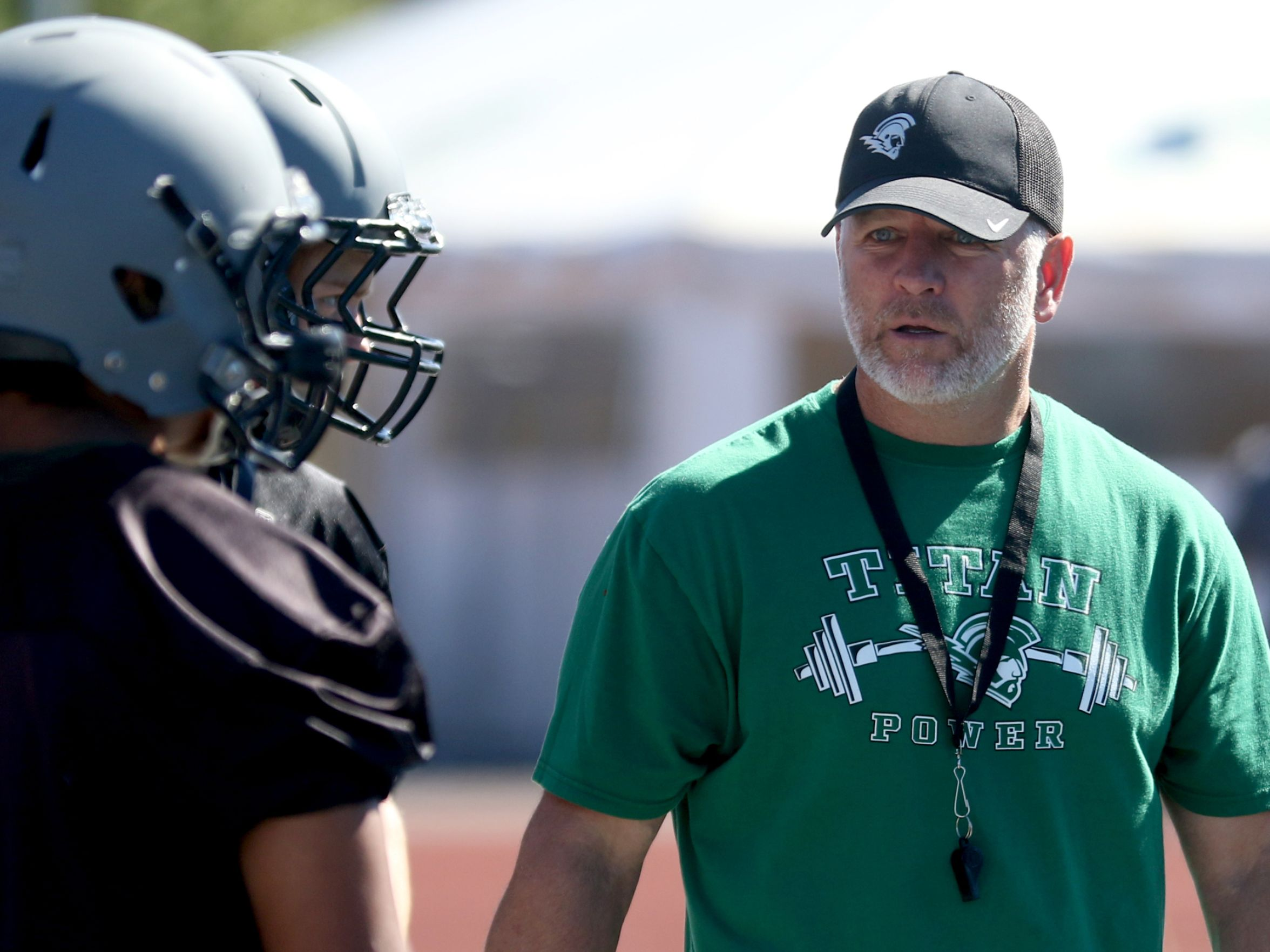 Head Coach Shawn Stanley talks to his players during football practice at West Salem High School. (Photo: Anna Reed, Statesman Journal)