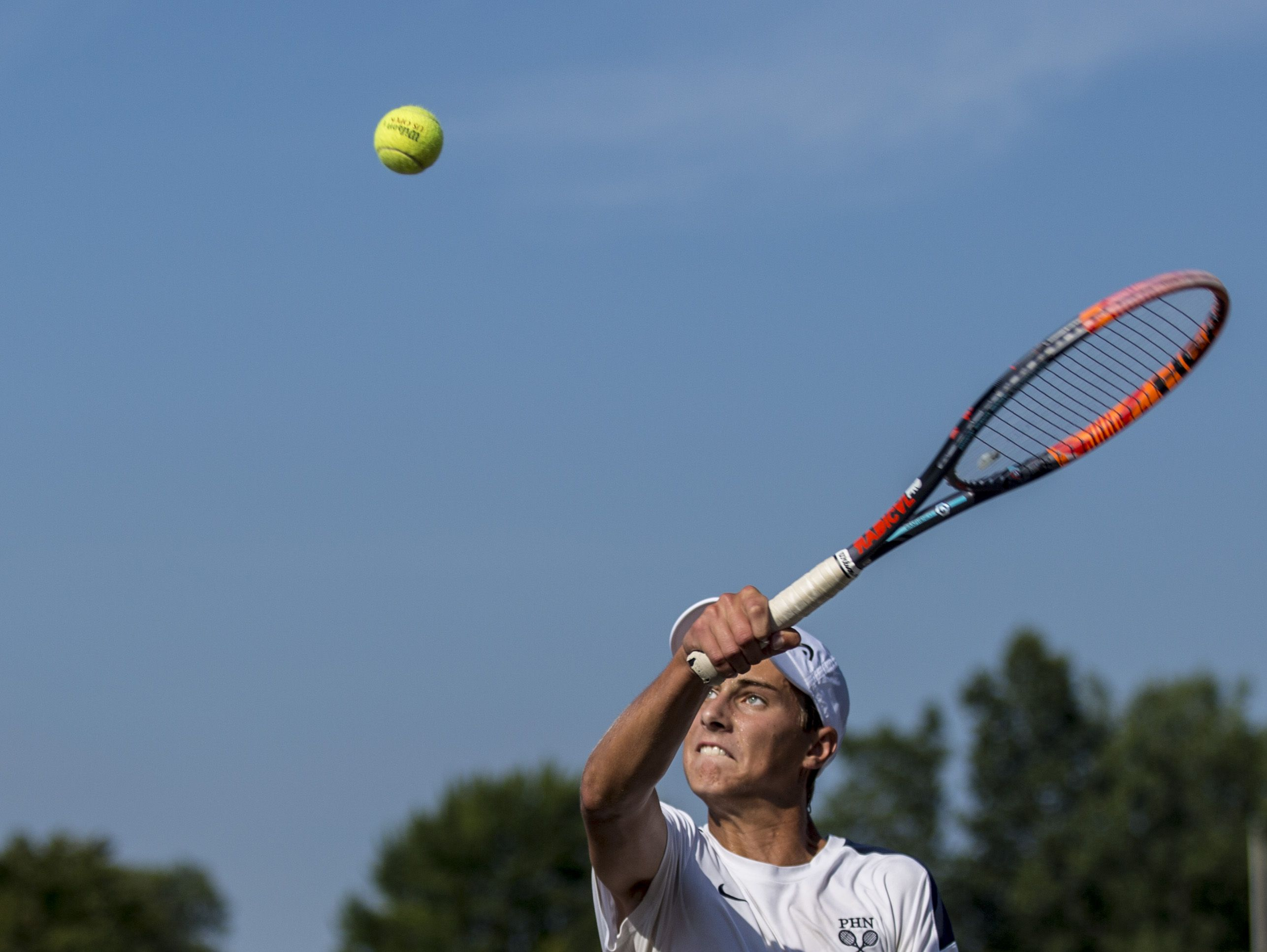 Port Huron Northern's Chris Adams returns the ball during tennis practice Tuesday, August 30, 2016 at Port Huron Northern High School.