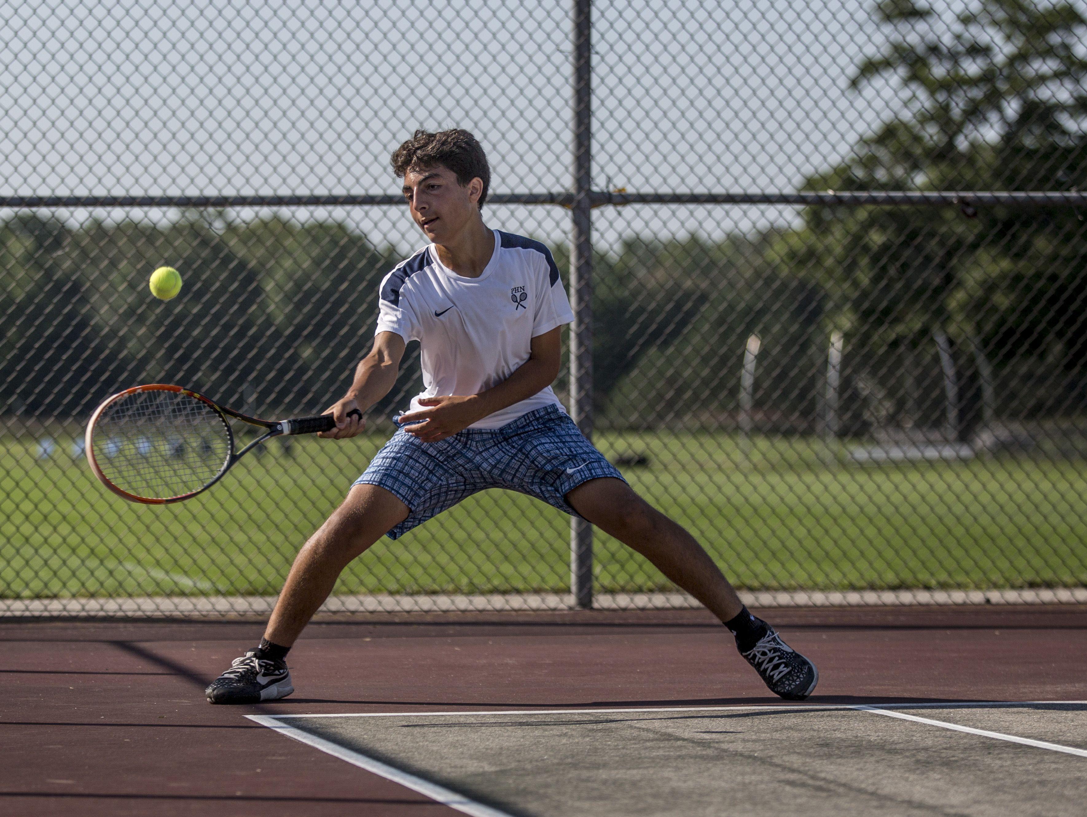 Port Huron Northern's Mina Naguib returns the ball during tennis practice Tuesday, August 30, 2016 at Port Huron Northern High School.