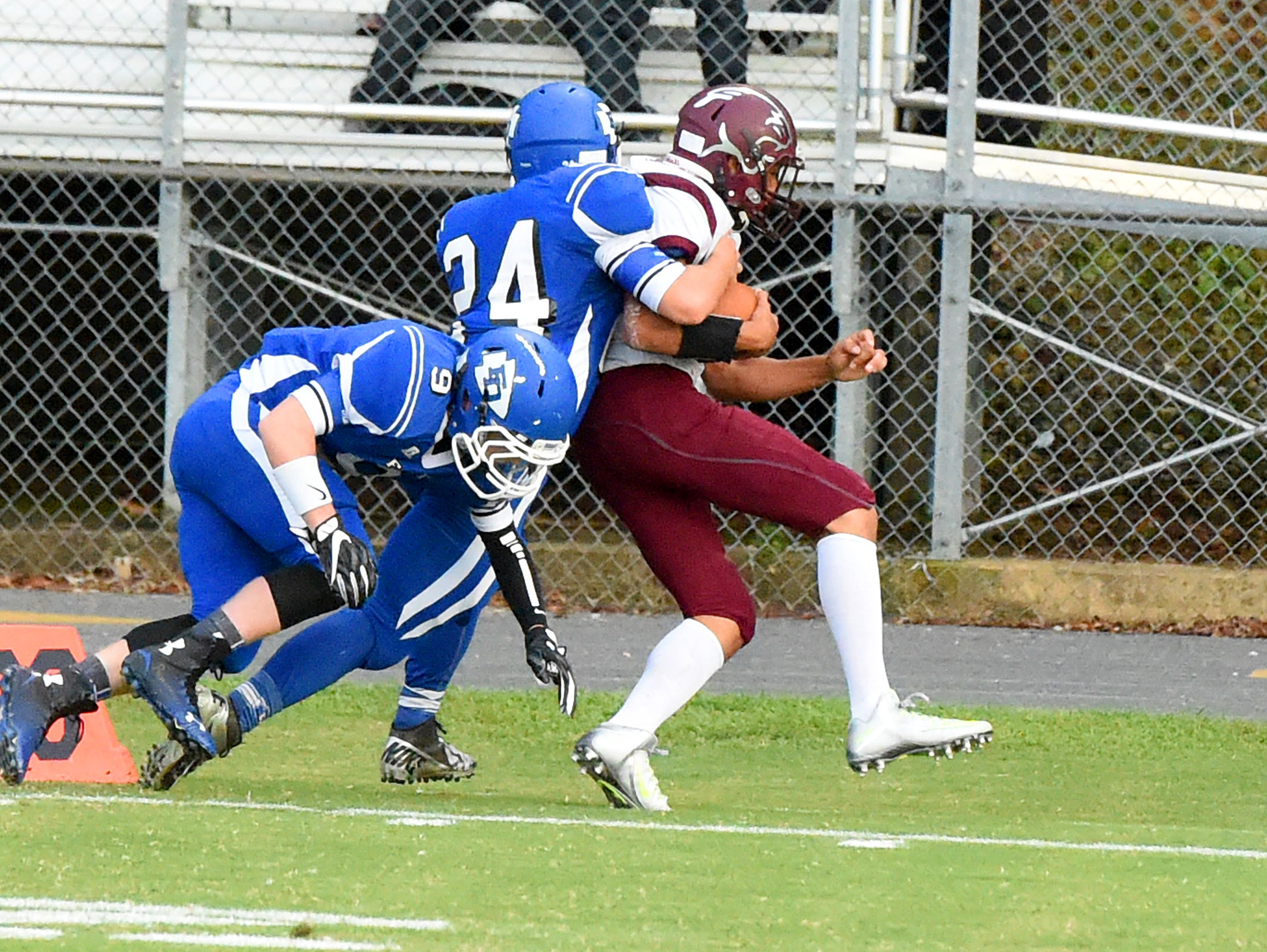 Stuarts Draft's Xzavier Gunn fights for more yards as he is slowly brought down by Fort Defiance's Steven Chittum and Matthew Wonderley during a football game played in Fort Defiance on Friday, Sept. 2, 2016.