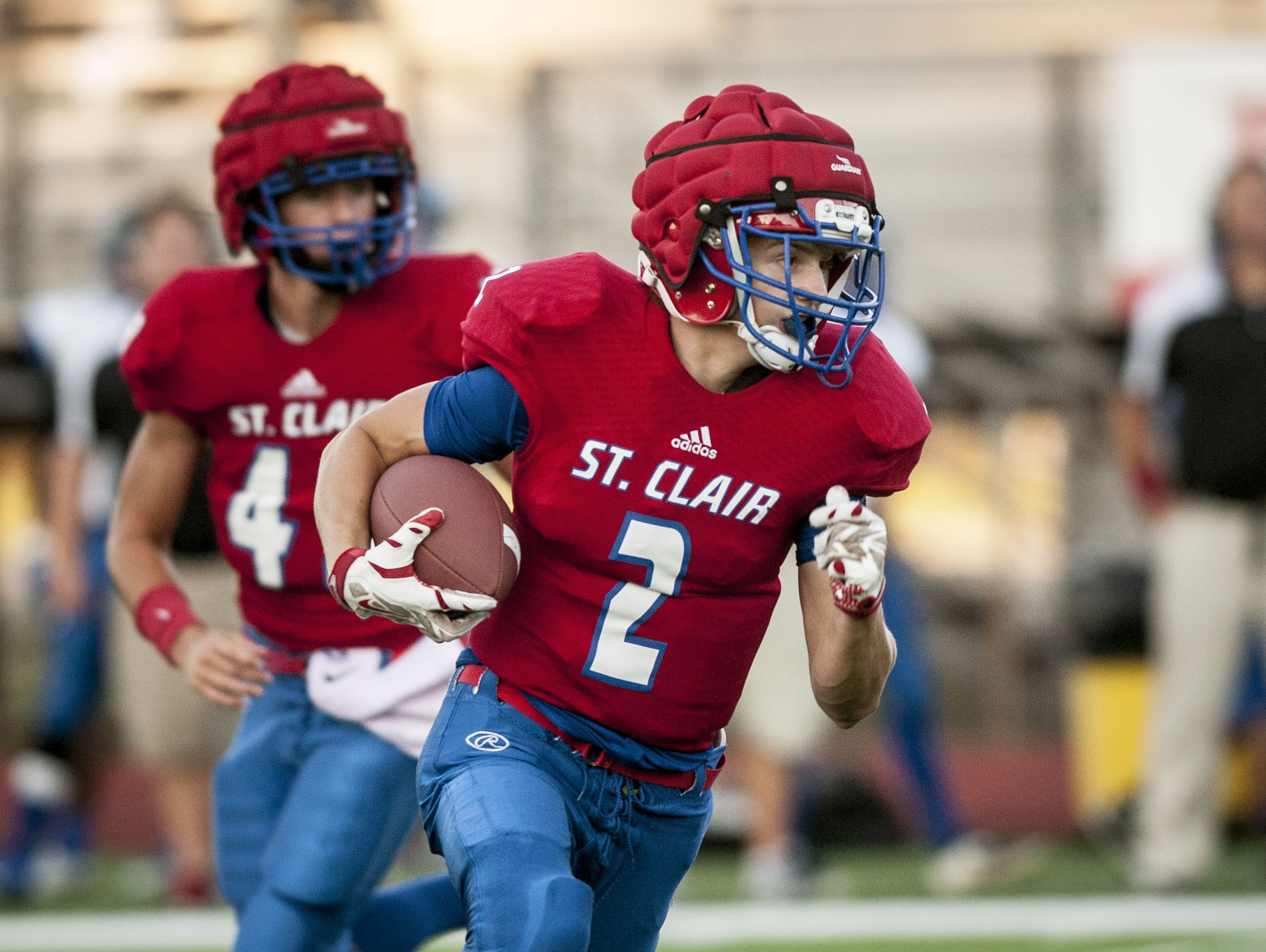 St. Clair's Ethan Mahn runs the ball during a football game Friday, September 2, 2016 at East China Stadium.