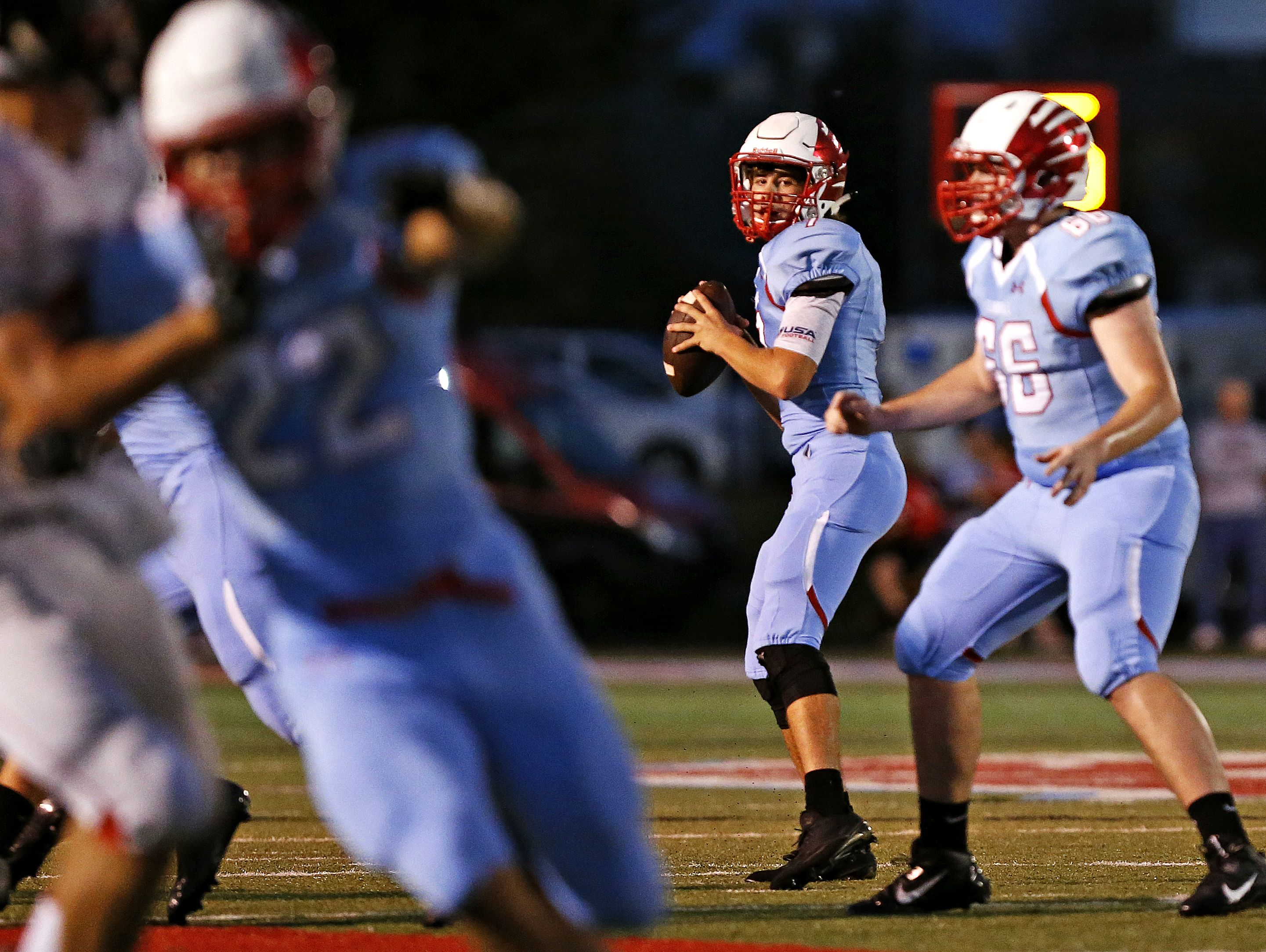 Glendale High School quarterback Alex Houston (7) gets ready to throw the ball during second quarter action of the Falcons game against West Plains High School at Lowe Stadium in Springfield, Mo. on Sept. 2, 2016.