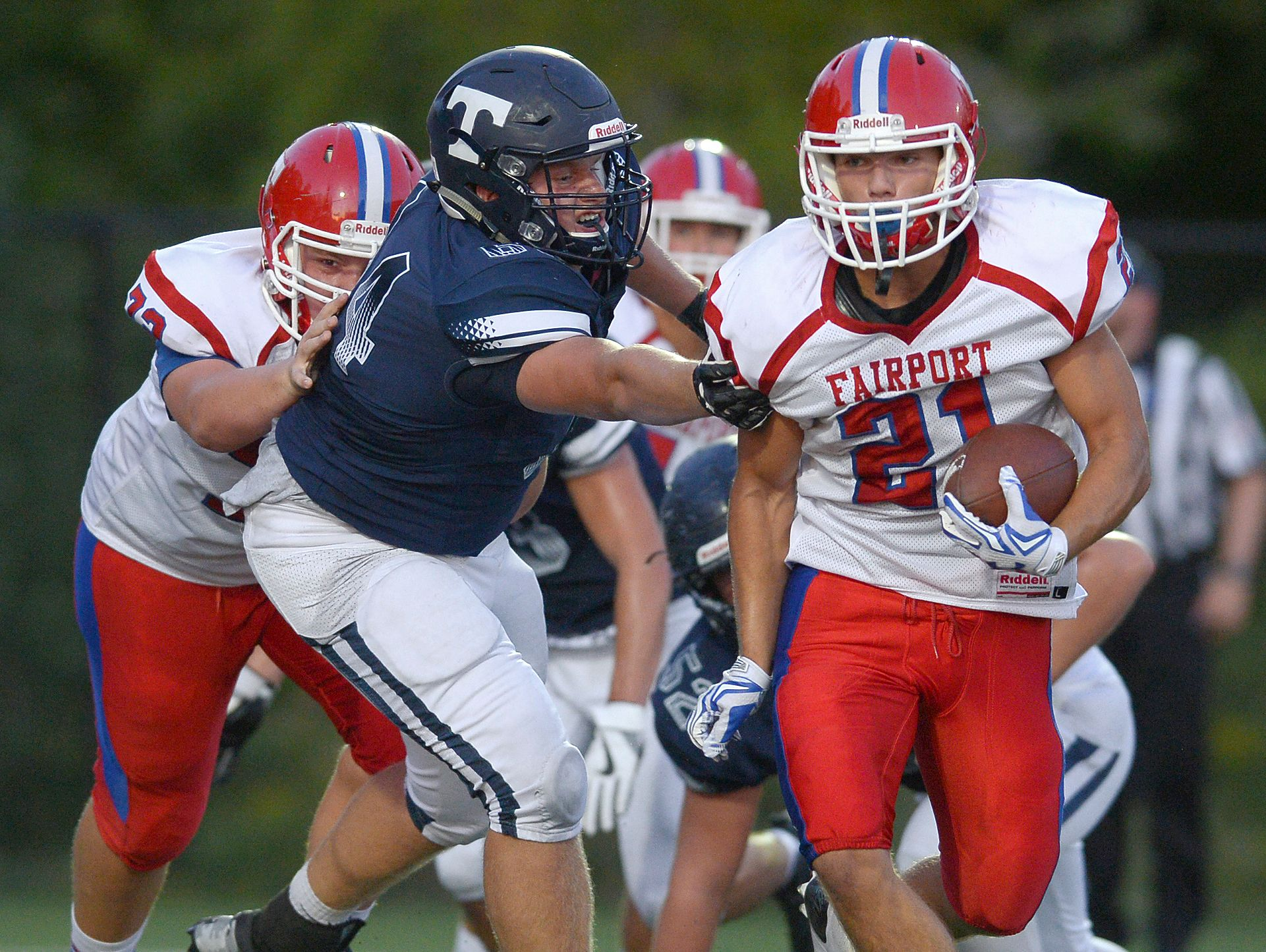Fairport's Dom Gombetto, right, eludes Webster Thomas' Tyler Curtis on his way to scoring the Raiders' third touchdown.