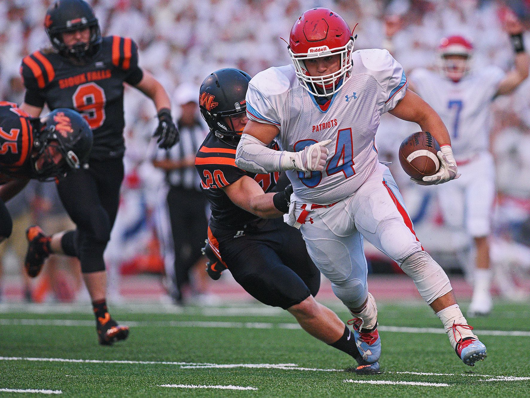 Lincoln's Cory Fichter (34) rushes for a touchdown during a Presidents Bowl game against Washington at Howard Wood Field Saturday, Sept. 3, 2016, in Sioux Falls.
