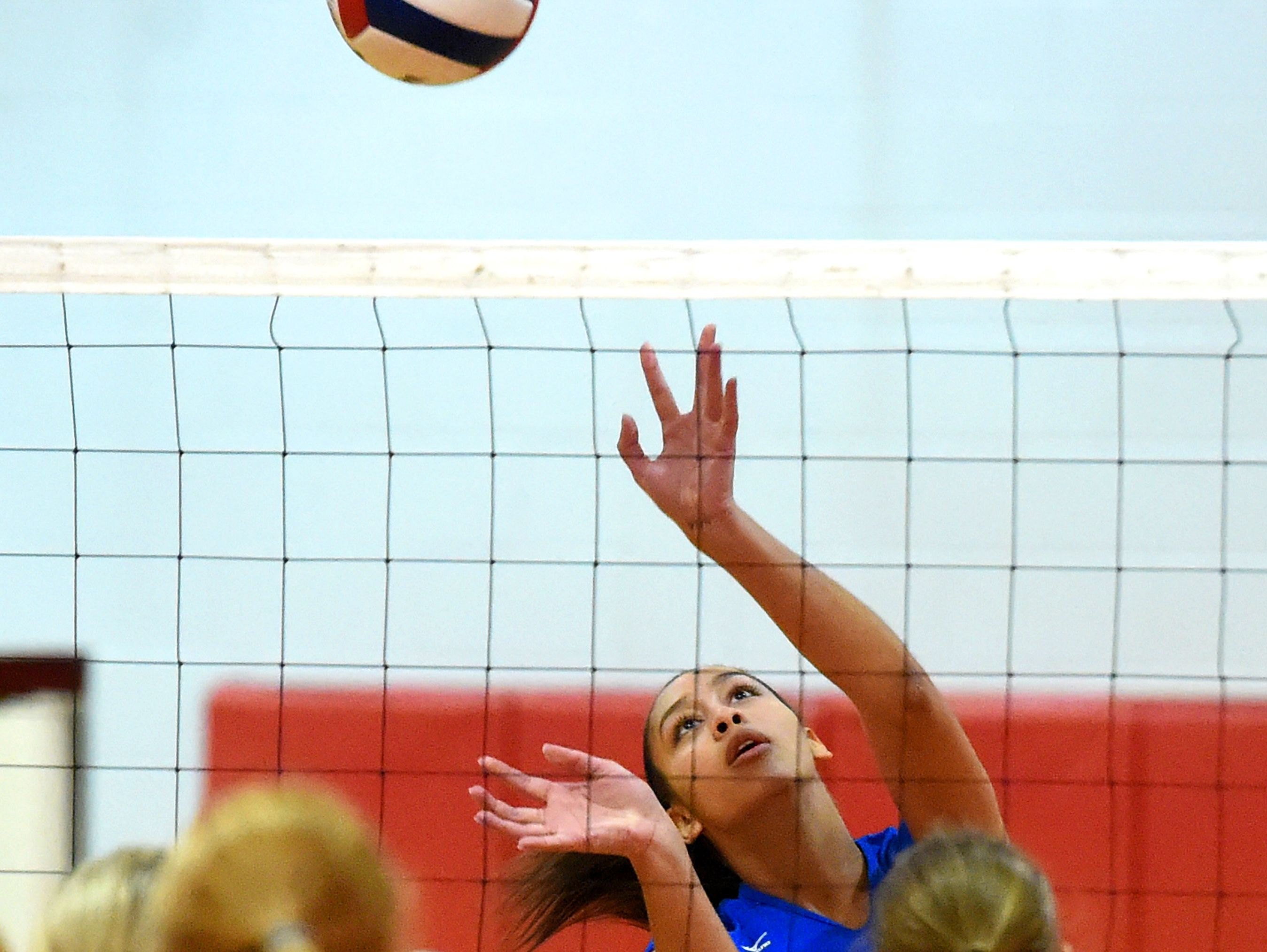 Fort Defiance's Jayden Beasley sets the ball during a volleyball match played in Greenville on Thursday, Sept. 9, 2016.