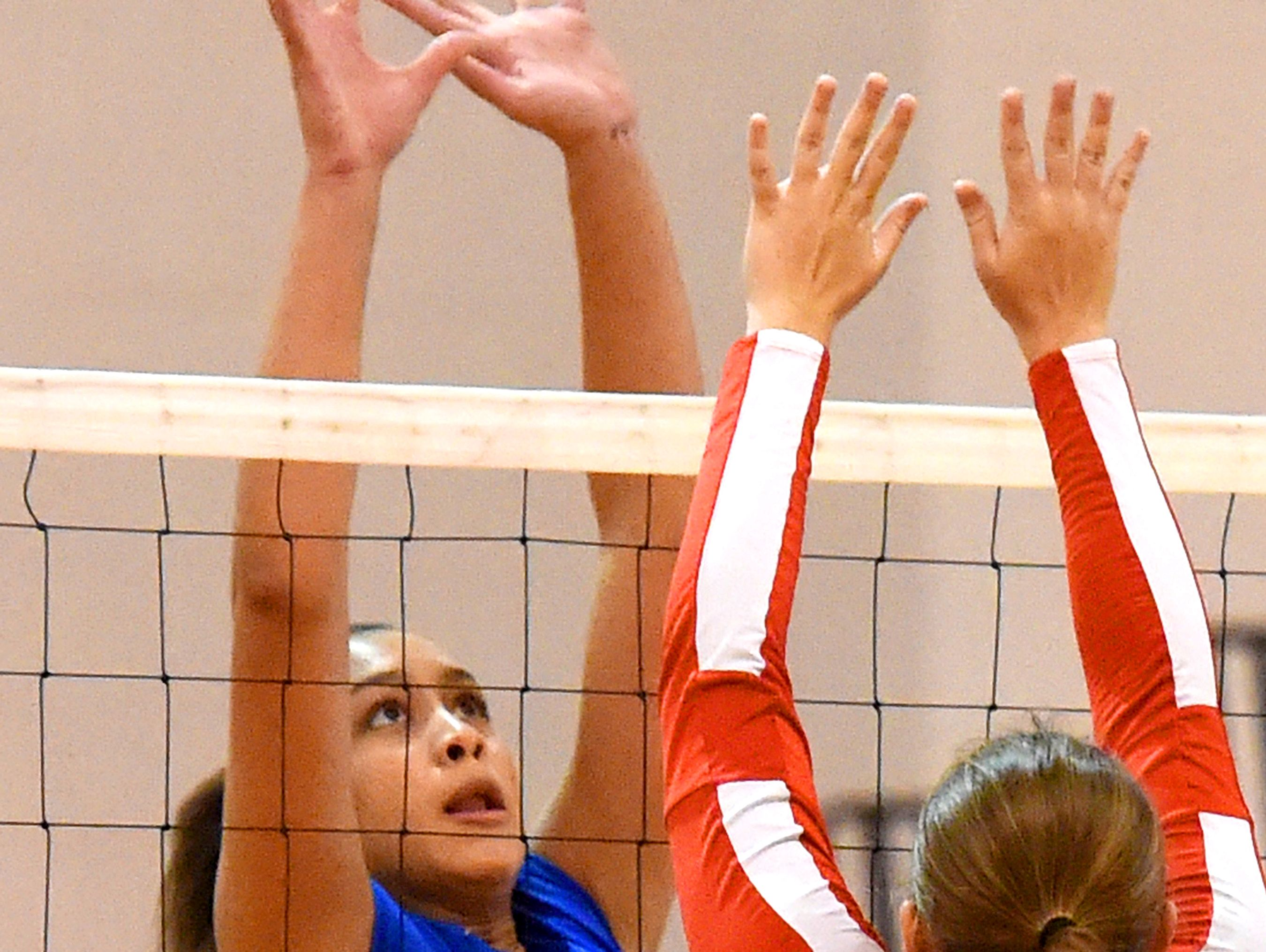Fort Defiance's Jayden Beasley faces off against Riverheads' Emma Casto at the net during a volleyball match played in Greenville on Thursday, Sept. 9, 2016.