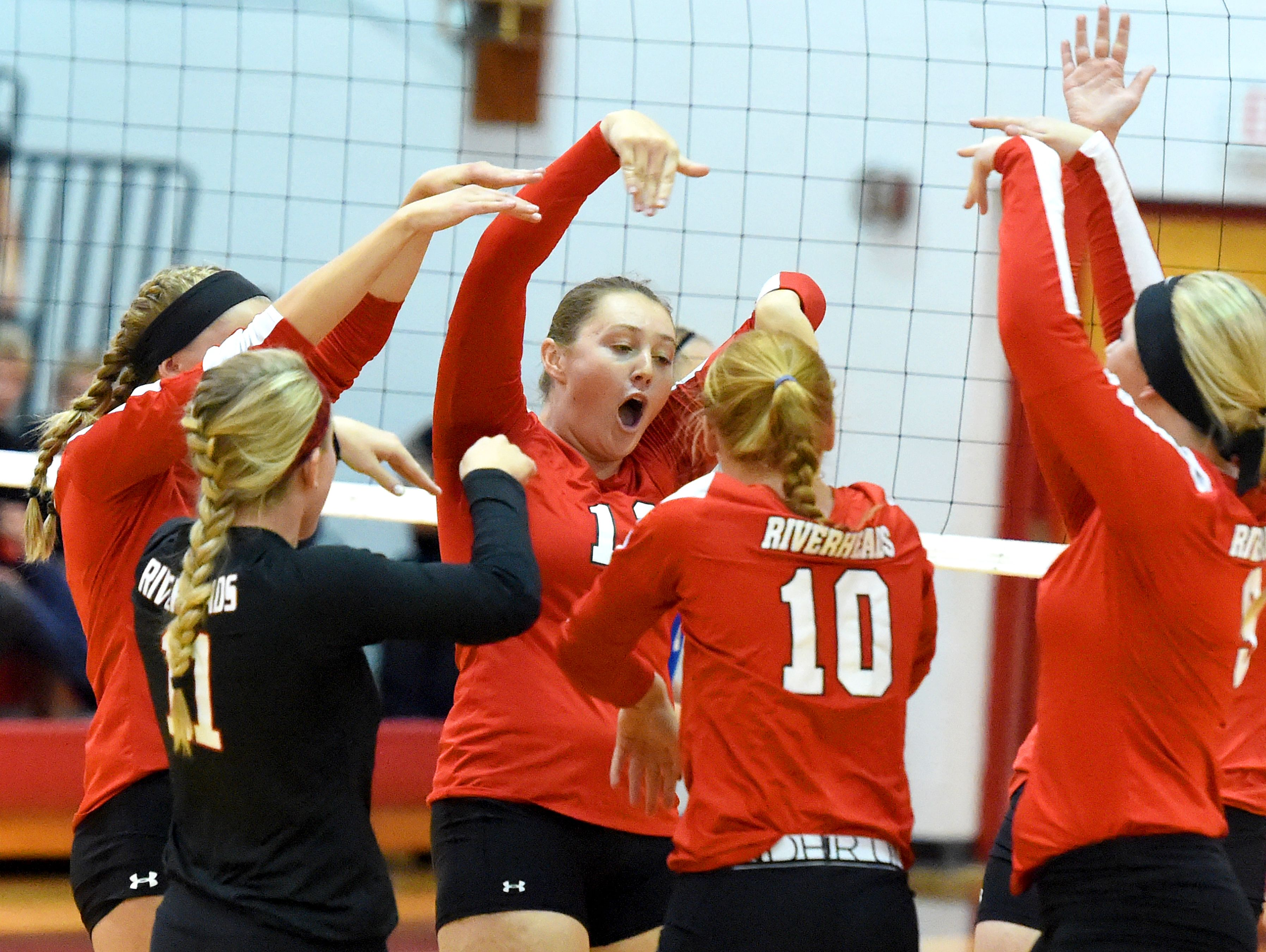 Riverheads' Emma Casto celebrates a point with teammates on the court during a volleyball match played in Greenville on Thursday, Sept. 9, 2016.