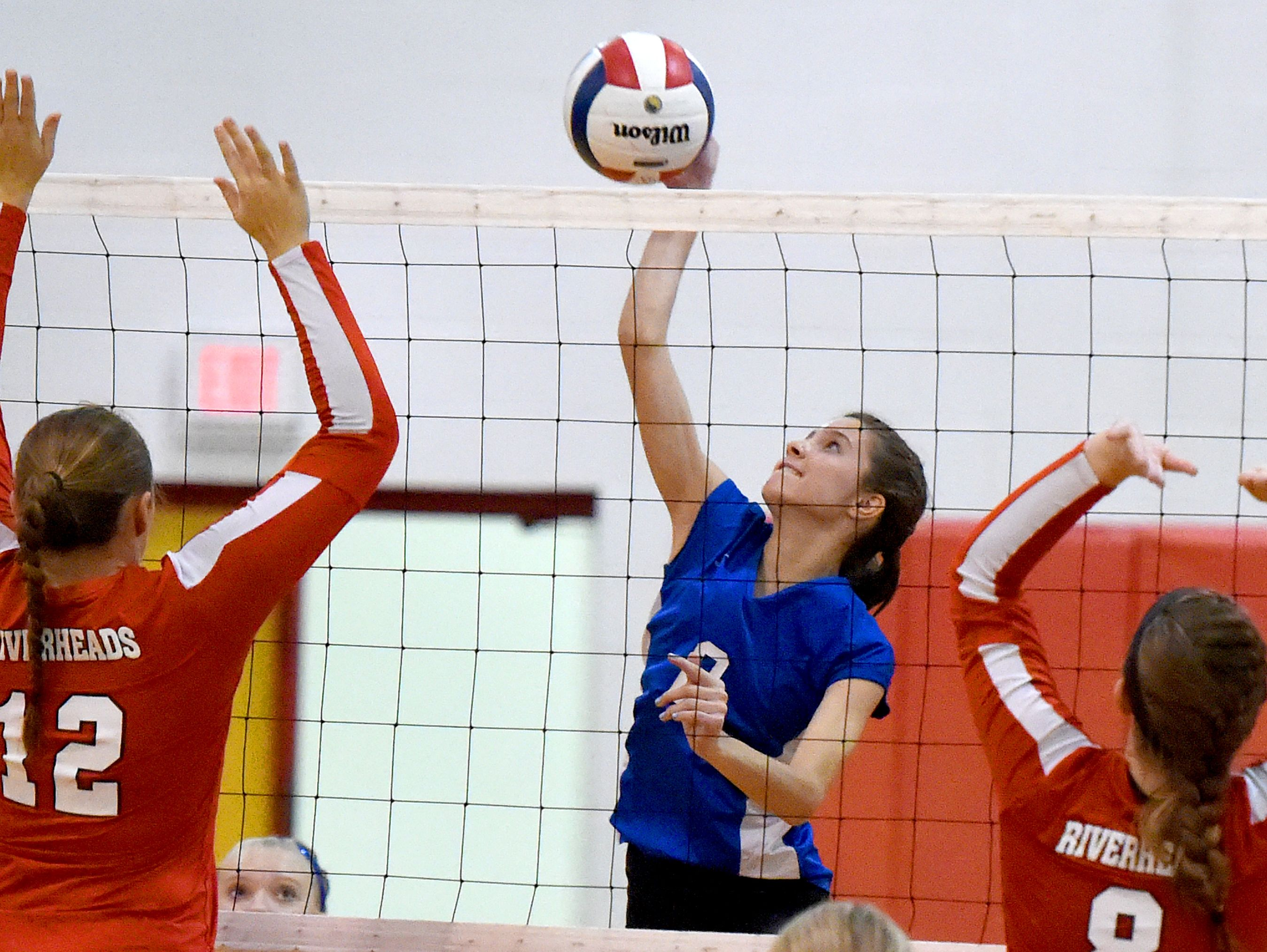 Fort Defiance's Casey Mozingo spikes the ball during a volleyball match played in Greenville on Thursday, Sept. 9, 2016.