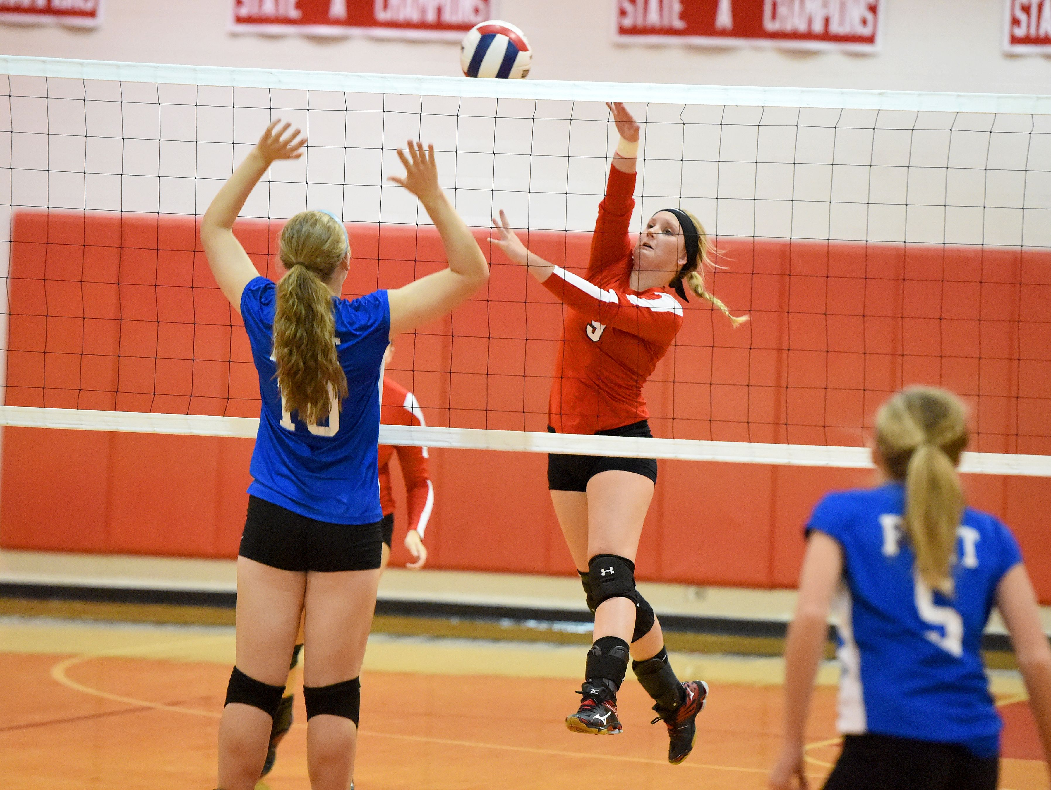 Riverheads' Macey Snyder spikes the ball across the net from Fort Defiance's Catie Cramer during a volleyball match played in Greenville on Thursday, Sept. 9, 2016.