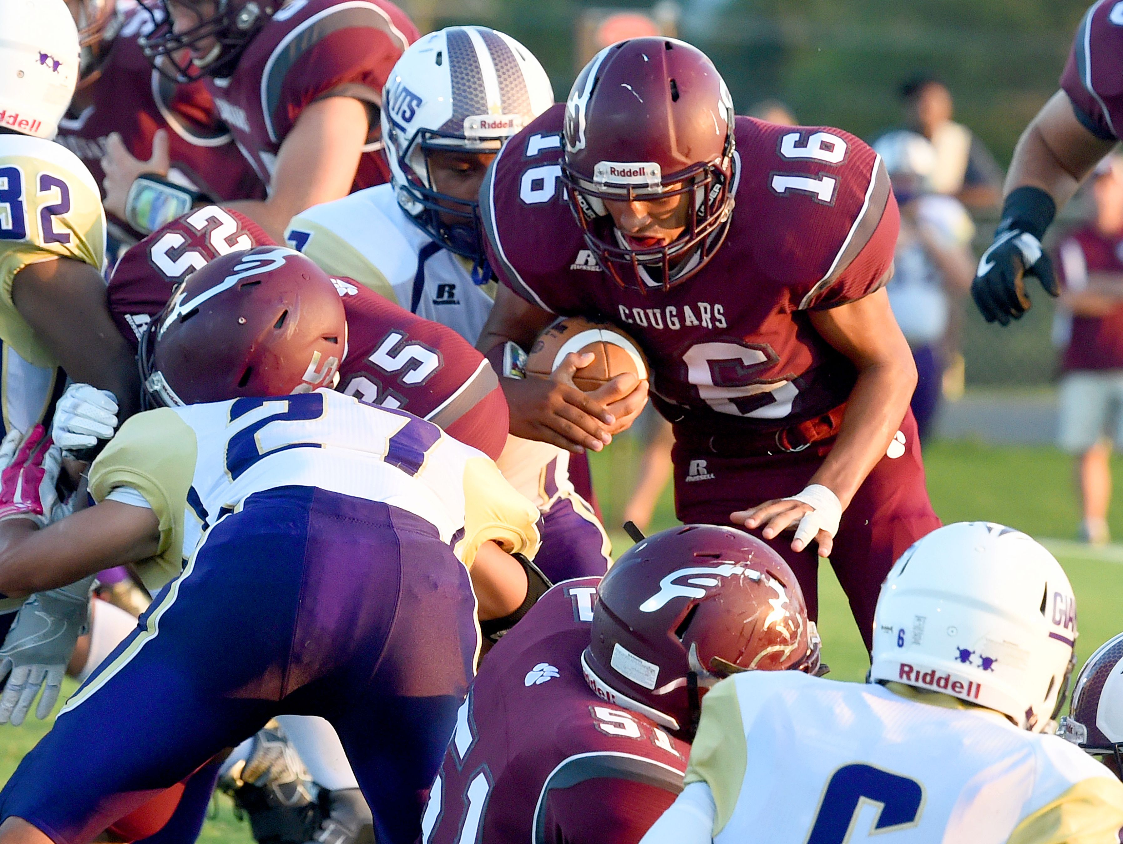 Stuarts Draft's Xzavier Gunn looks for a way through with the ball during a football game played in Stuarts Draft on Friday, Sept. 9, 2016.