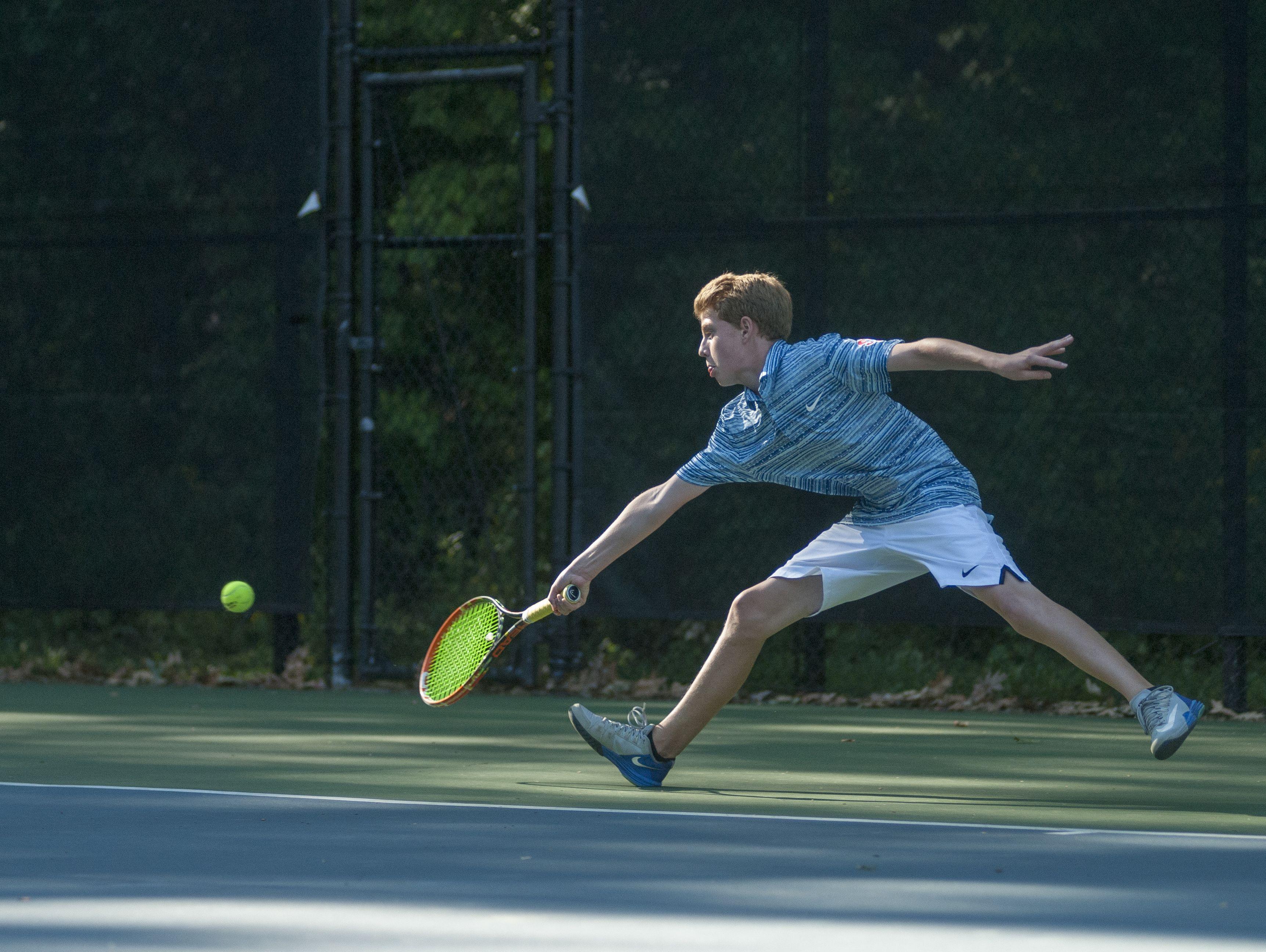 Saints' Eli Pinnoo reaches for a ball Monday, Sept. 12, during boys tennis action at Sanborn Park tennis courts.