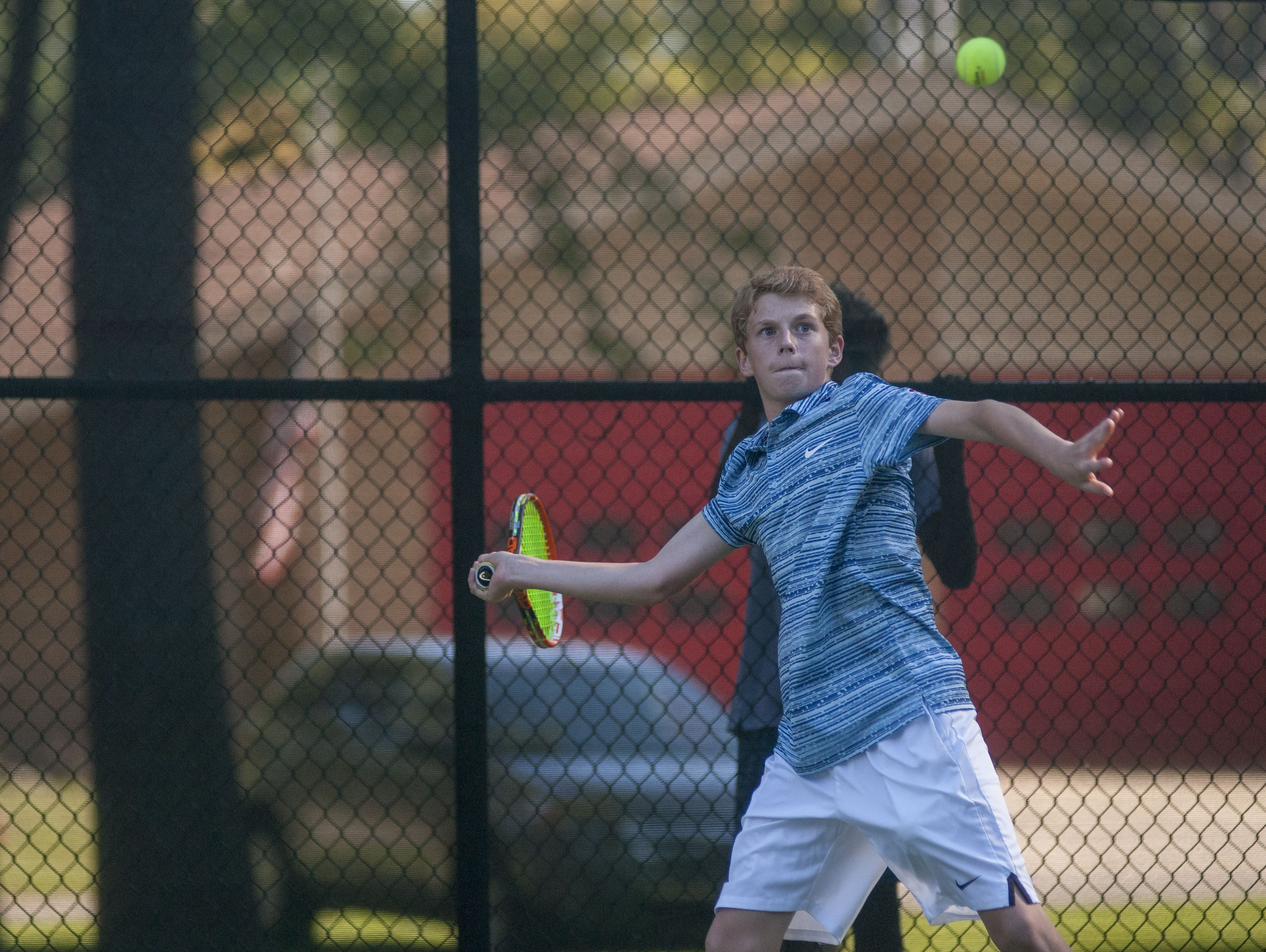 Saints' Eli Pinnoo keeps his eyes on the ball Monday, Sept. 12, during boys tennis action at Sanborn Park tennis courts.