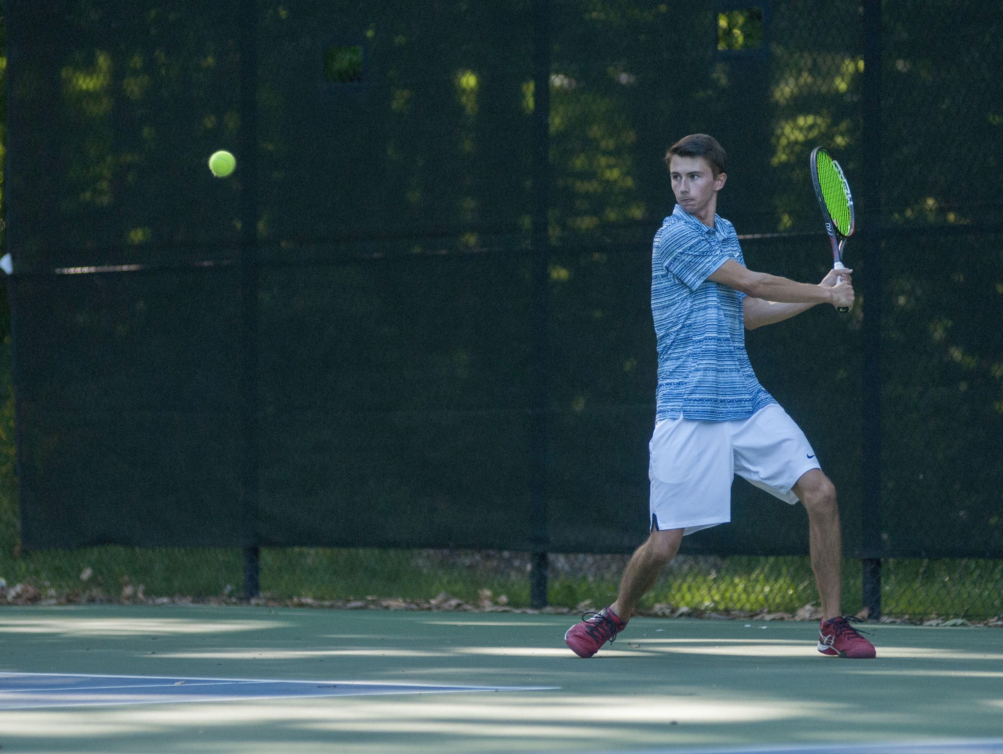 Saints' Seth Pinnoo readies a return Monday, Sept. 12, during boys tennis action at Sanborn Park tennis courts.