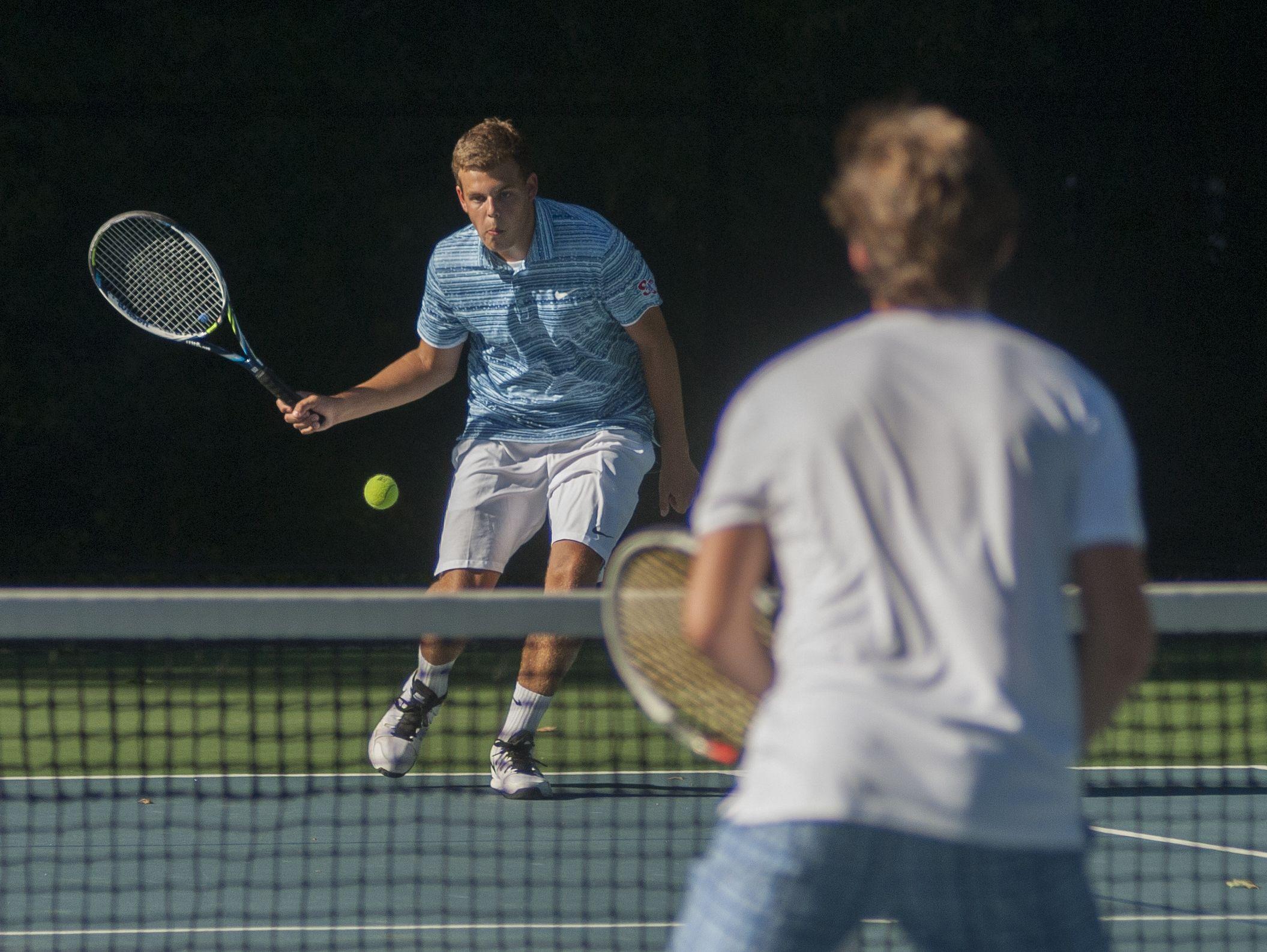 Saints' Griffin Vigneron readies to hit the ball Monday, Sept. 12, during boys tennis action at Sanborn Park tennis courts.