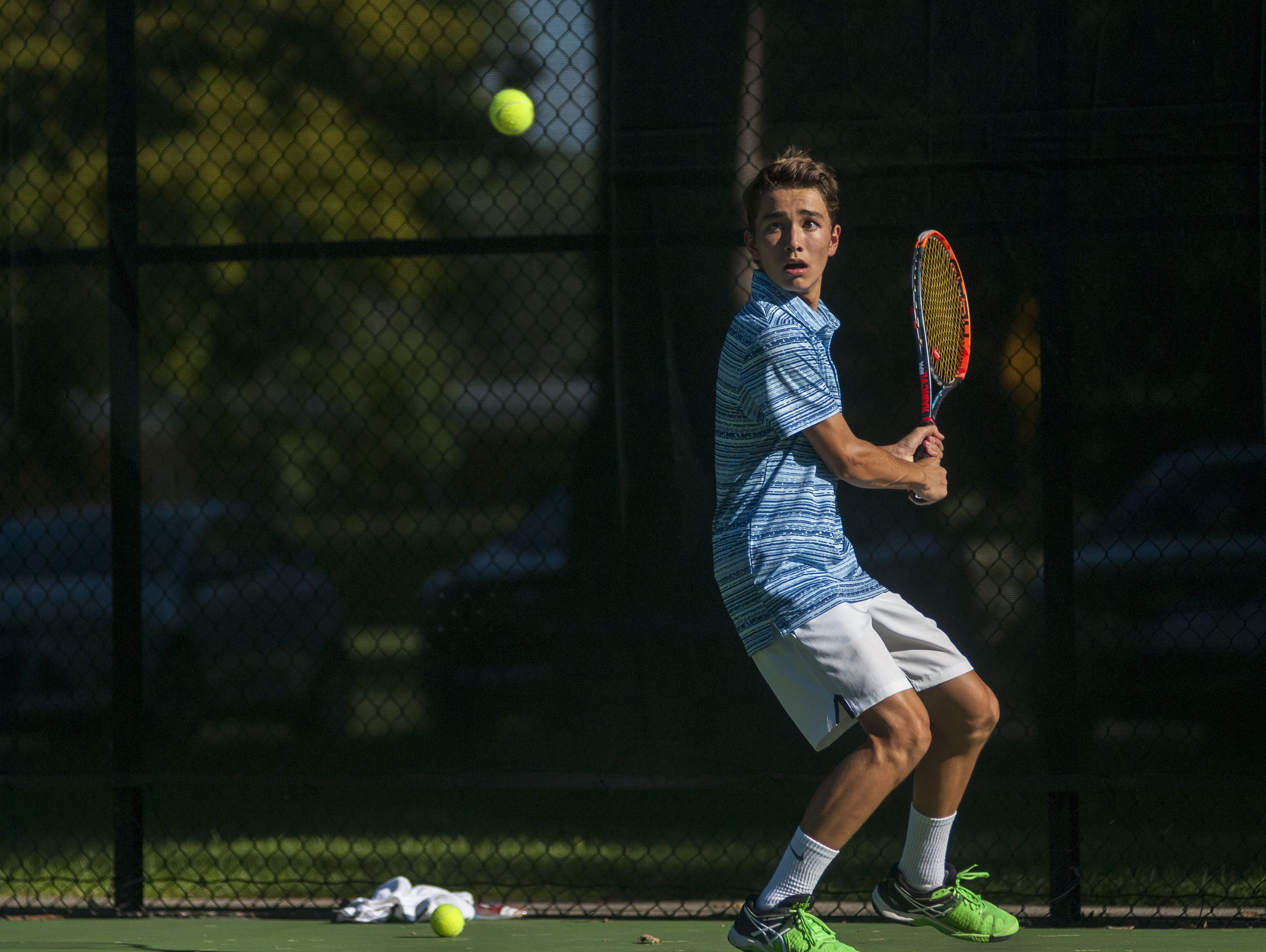Saints' John Mason readies to return a serve Monday, Sept. 12, during boys tennis action at Sanborn Park tennis courts.