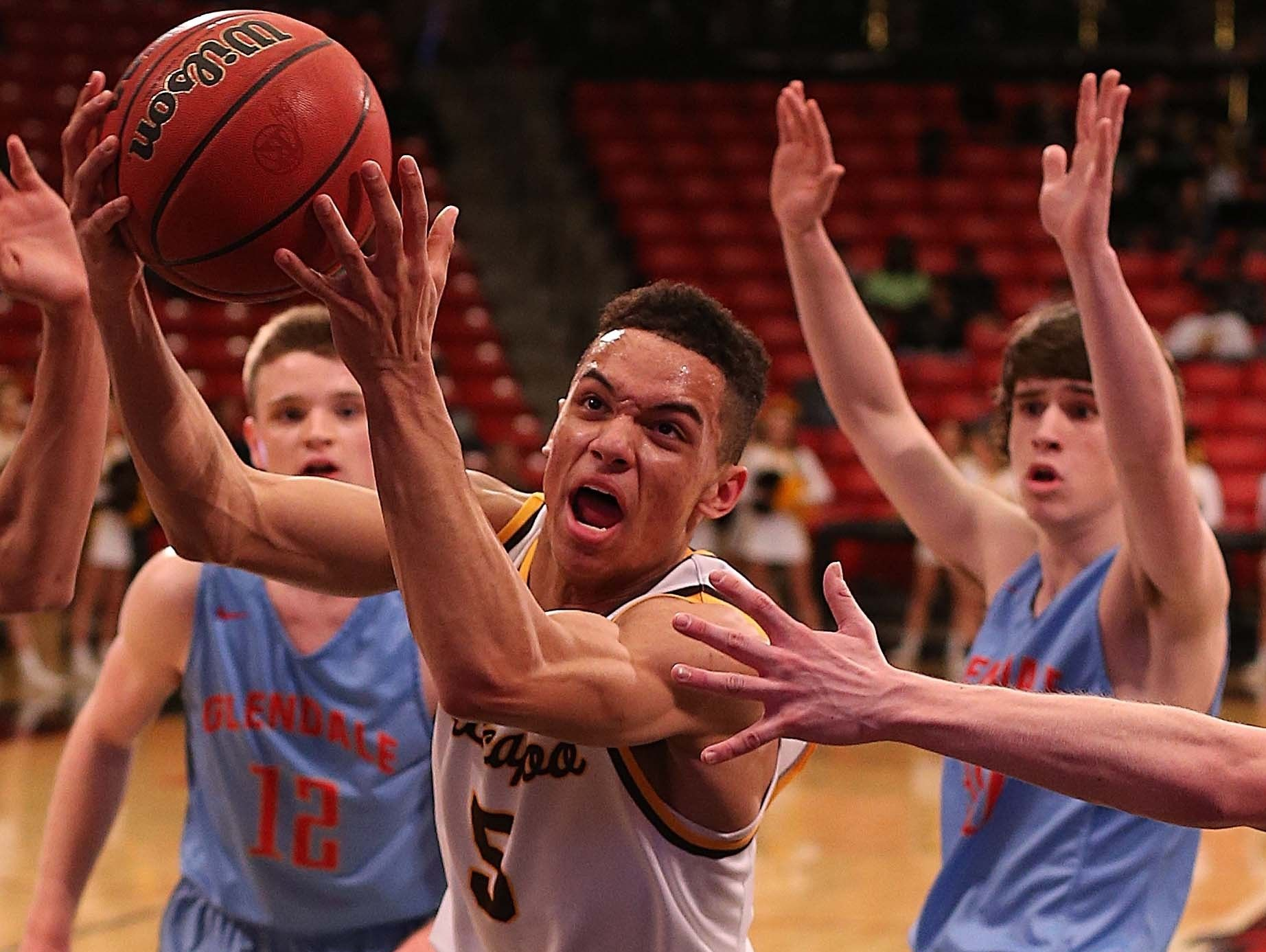 Kickapoo's Cameron Davis (center) announced his commitment to play basketball at Navy on Sept. 12, 2016.