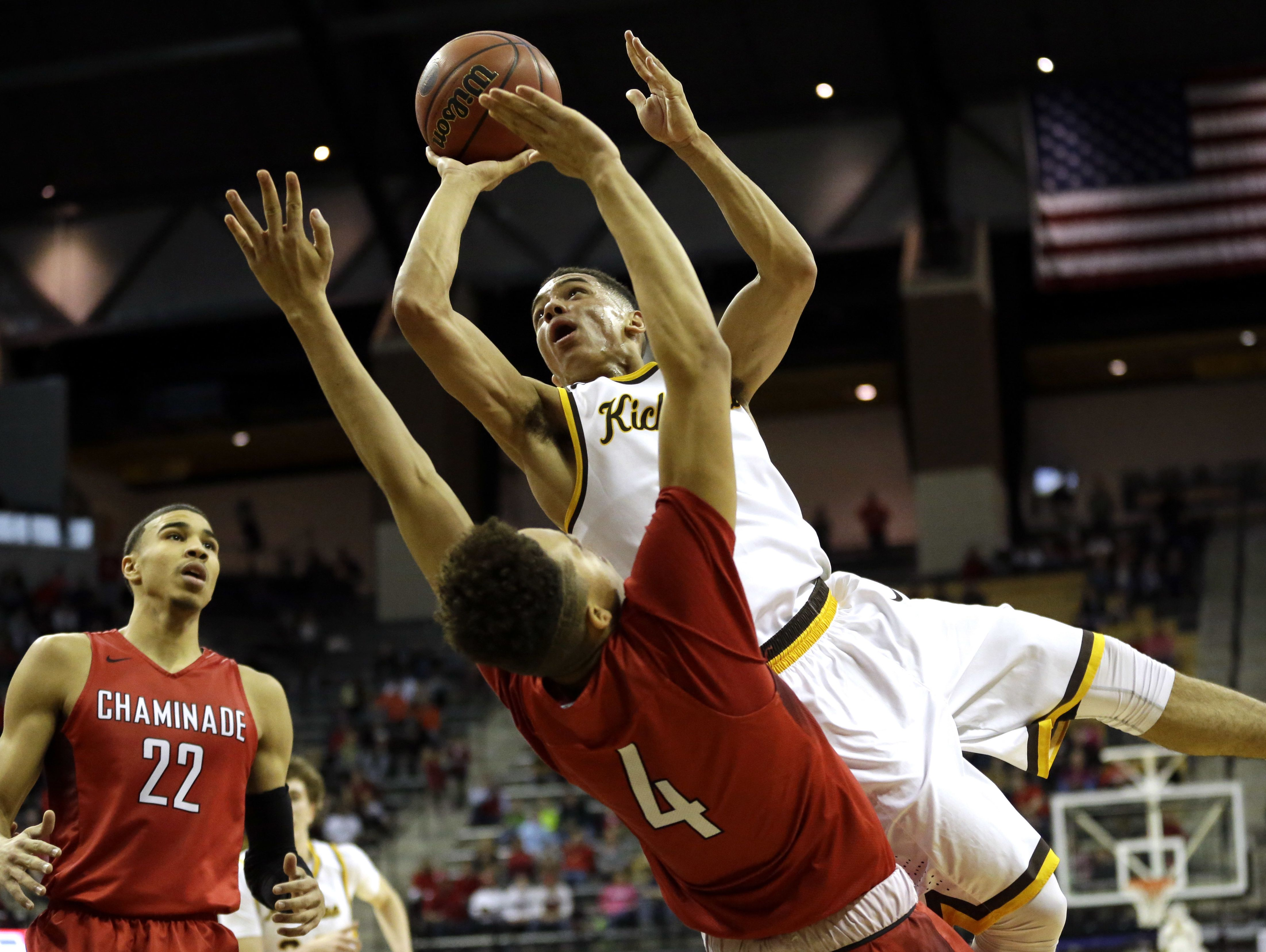 Kickapoo's Cameron Davis, top center, is fouled on his way to the basket by Chaminade's Jericole Hellems (4) as Chaminade's Jayson Tatum (22) watches during the second half of the 2016 Missouri Class 5 boys' high school championship game in Columbia.