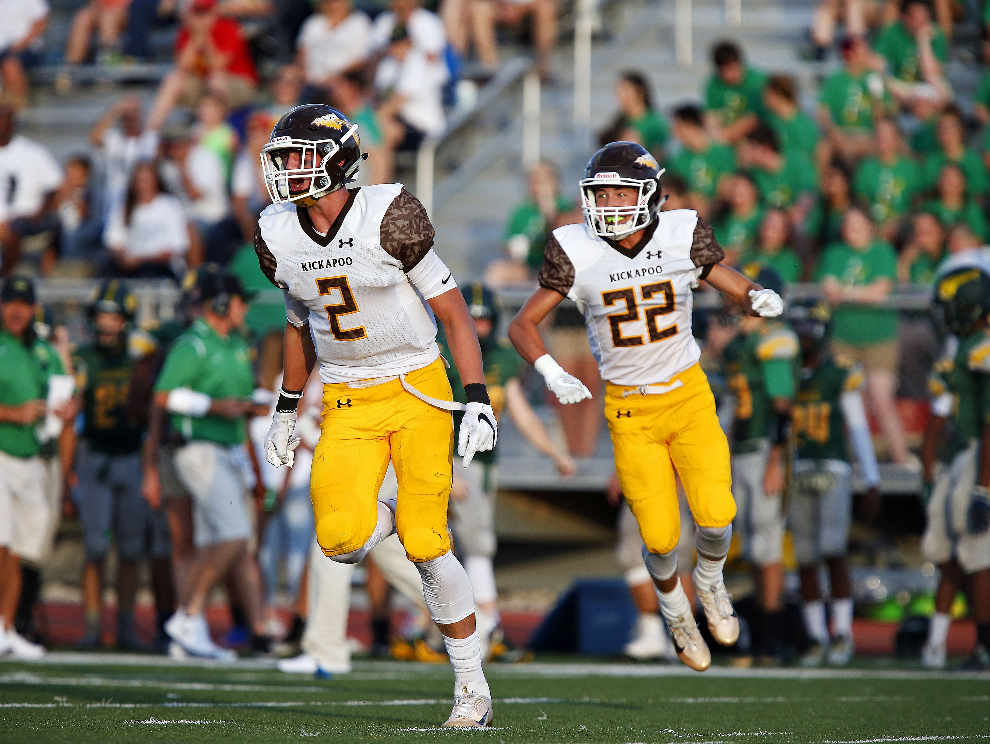 Kickapoo High School linebacker Travis Vokolek (2) and safety Cole McCarville (22) celebrate after the Chiefs defense forced a turnover during a 2016 game against Parkview. The Chiefs are 4-0 and hold the top spot in Class 6 District 4.