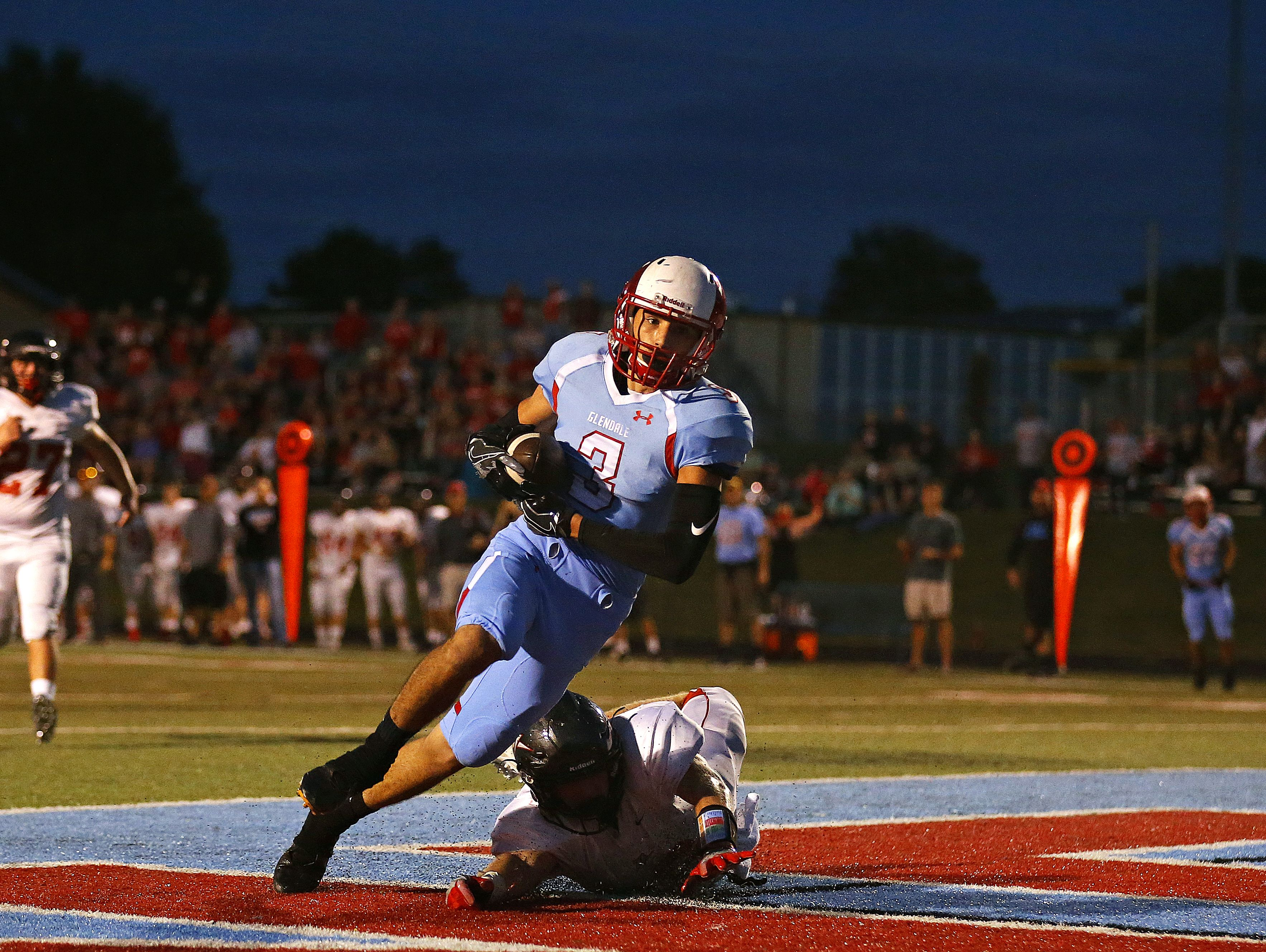 Glendale wide receiver Corbin Lukes catches a touchdown pass from quarterback Alex Huston (not pictured) against West Plains at Lowe Stadium in Springfield.