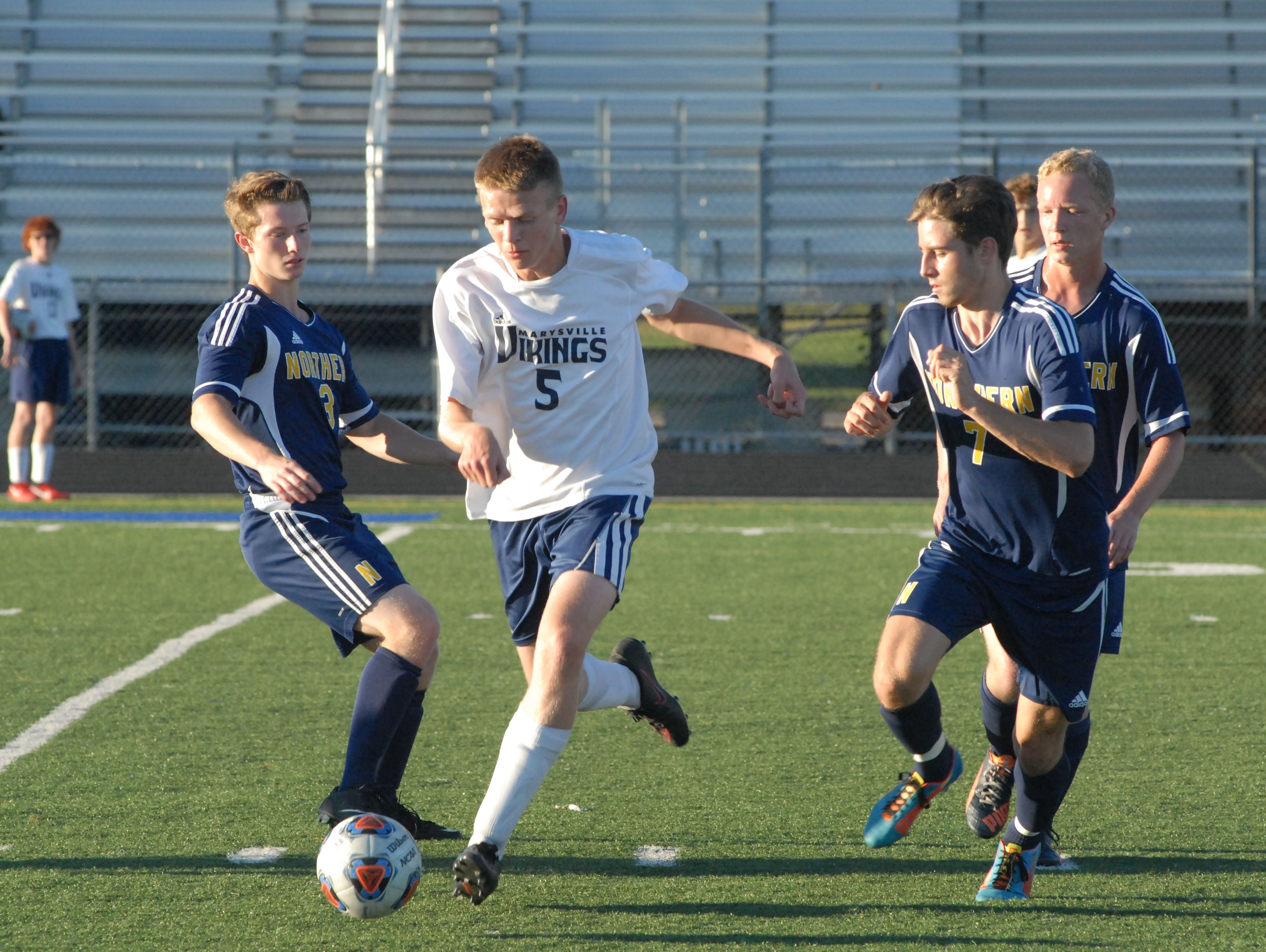 Marysville's Alex Chitwood dribbles the ball through traffic in the first half of the Vikings 2-1 win on Sept. 14, 2016.
