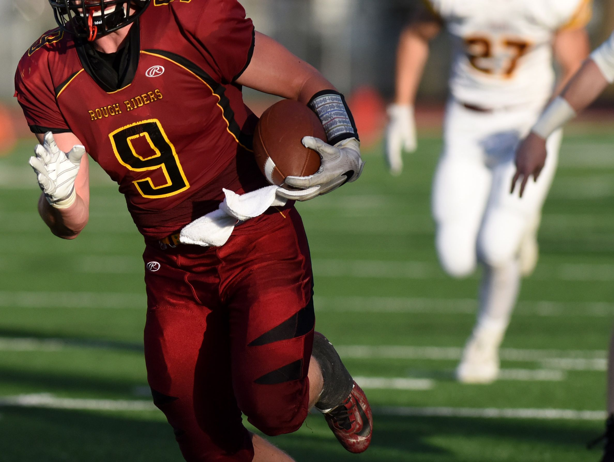 Roosevelt's Carter Carstens gains yardage against Harrisburg during their game at Howard Wood Field on Friday.