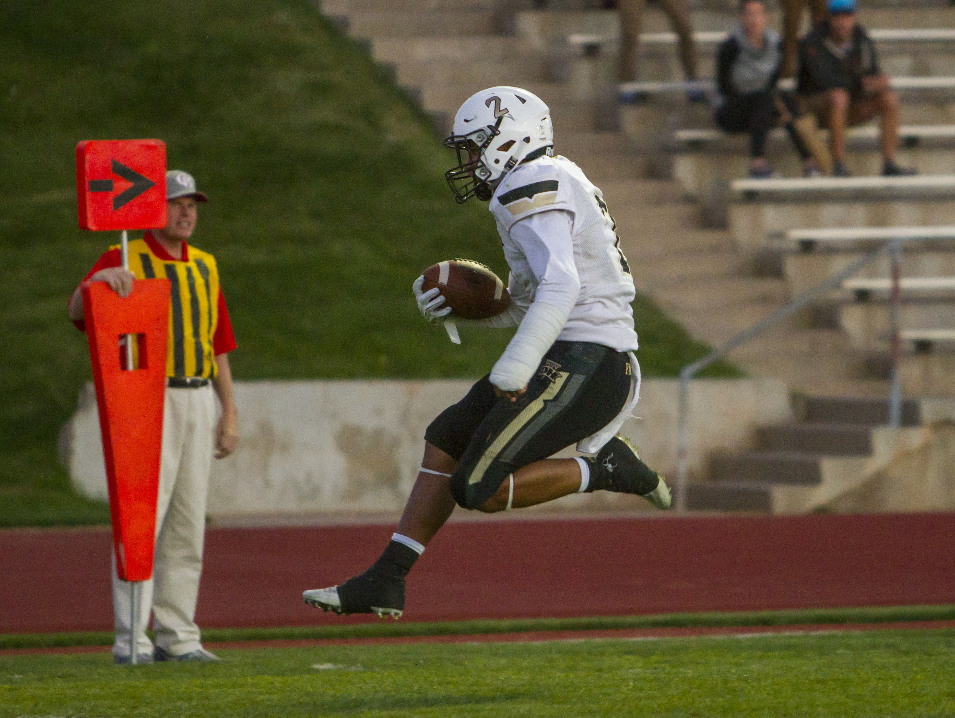 Desert Hills cornerback Nephi Sewell (2) high-steps into the end zone after intercepting a pass during Friday's game against Cedar in Cedar City, Sept. 16, 2016.