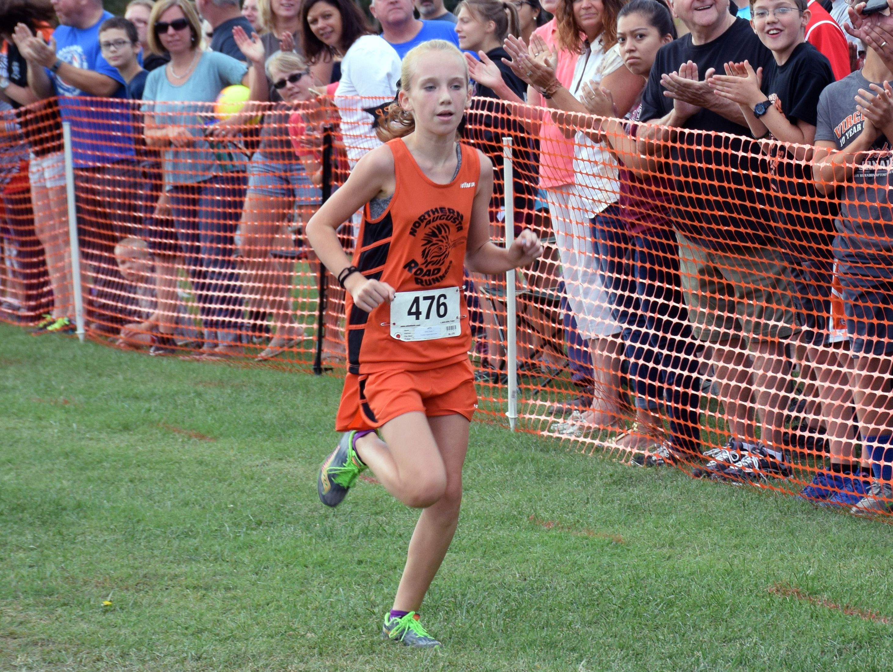 Emma Staley of the North Augusta Running Club heads to the finish line to win the middle school girls race at the Augusta County Cross Country Invitational at Wilson Workforce and Rehabilitation Center in Fishersville, Va., on Saturday, Sept. 17, 2016.