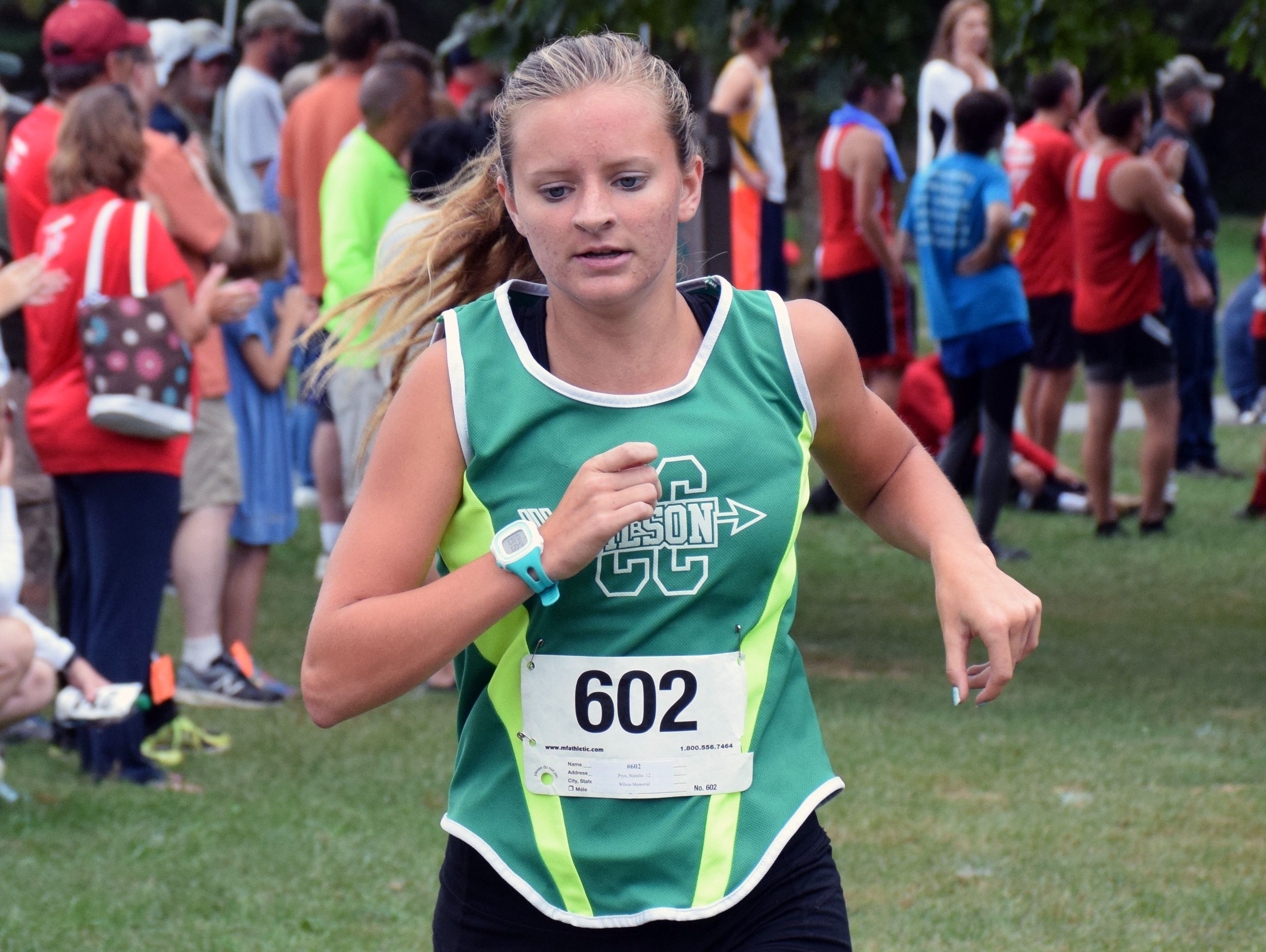 Wilson Memorial's Natalie Prye maintains her lead during the varsity girls race at the Augusta County Cross Country Invitational at Wilson Workforce and Rehabilitation Center in Fishersville, Va., on Saturday, Sept. 17, 2016. Prye went on to win the race.