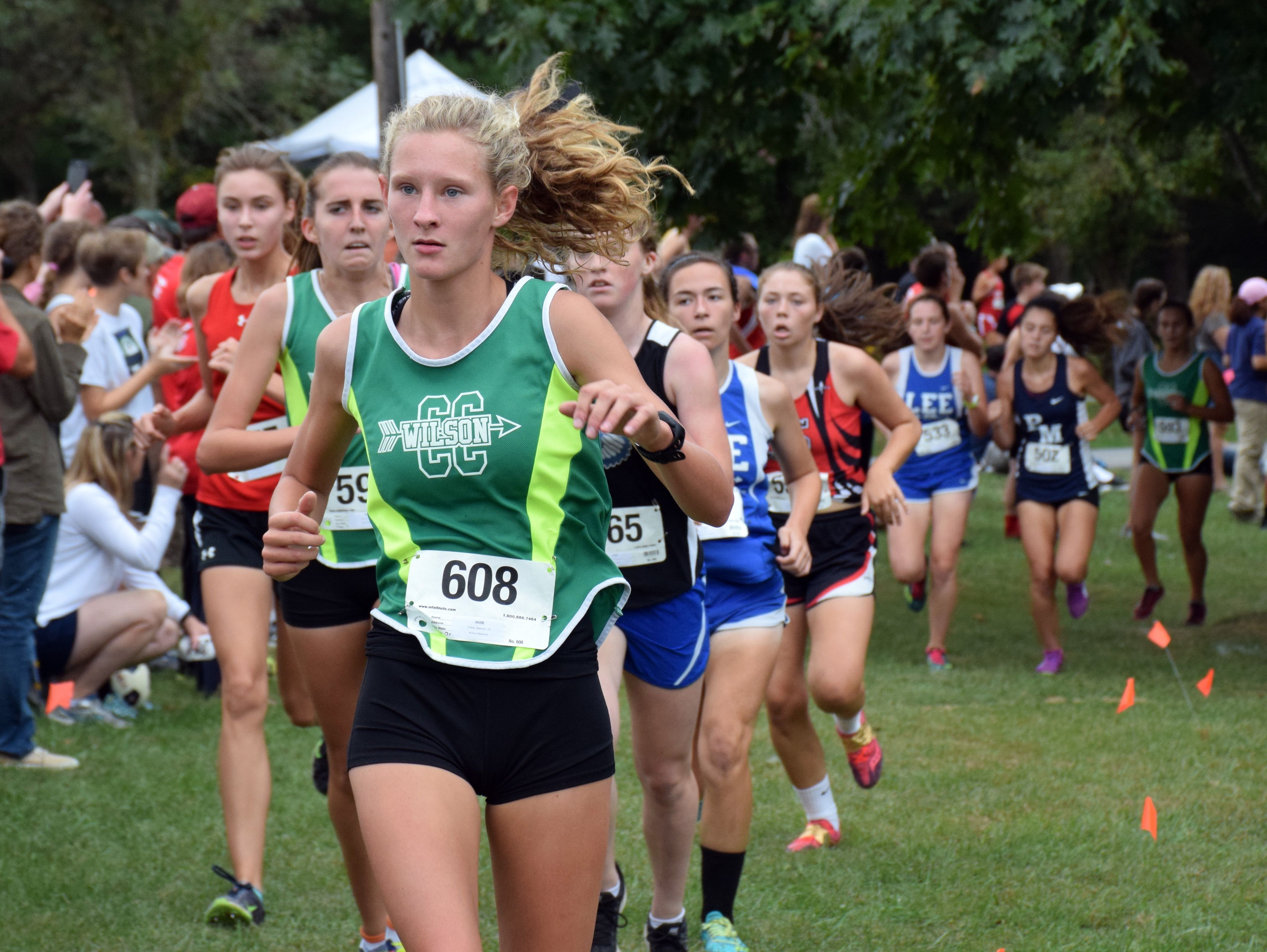 Wilson Memorial's Spencer Tuttle leads a pack of runners chasing the leads during the varsity girls race race at the Augusta County Cross Country Invitational at Wilson Workforce and Rehabilitation Center in Fishersville, Va., on Saturday, Sept. 17, 2016.