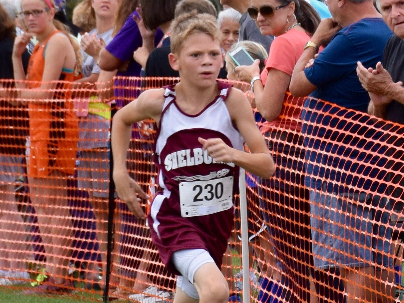 T.J. Connor of Shelburne Middle School sprints to the finish of the middle school boys race at the Augusta County Cross Country Invitational, held at Wilson Workforce and Rehabilitation Center in Fishersville, Va., on Saturday, Sept. 17, 2016. Connor finished second.