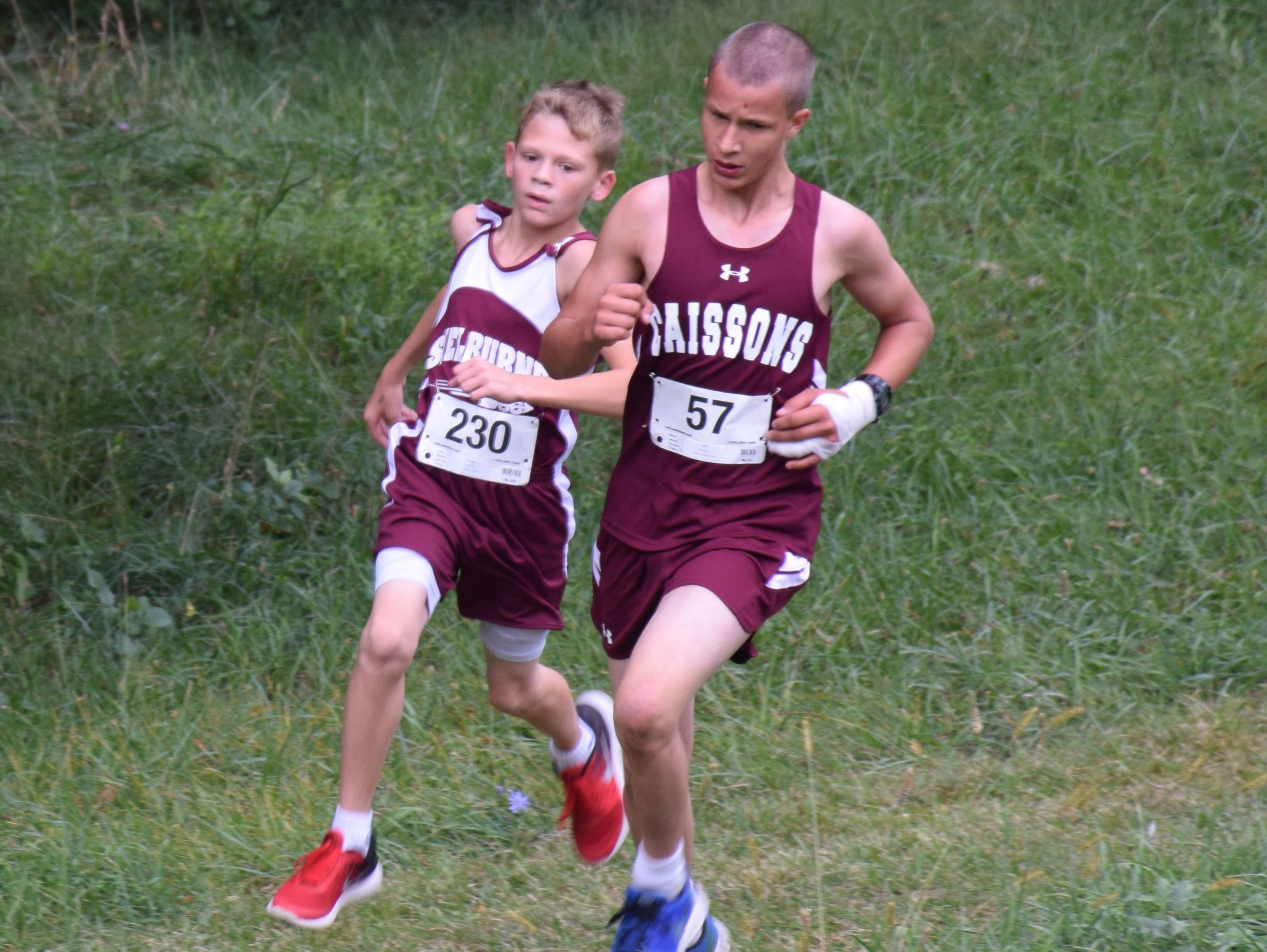 Fishburne Military School's Elijah Jackson, right, and Shelburne Middle School's T.J.Connor negotiate a turn during the middle school boys race at the Augusta County Cross Country Invitational at the Wilson Workforce and Rehabilitation Center in Fishersville on Saturday, Sept. 17, 2016.