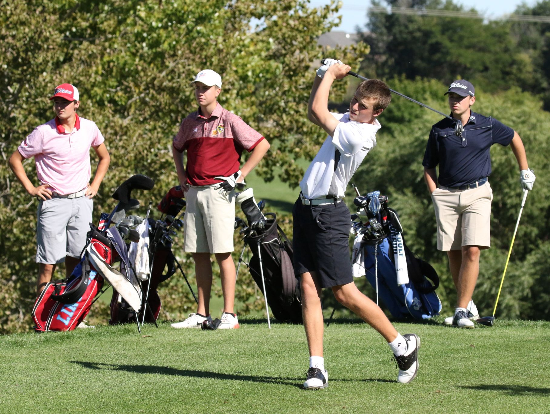 Will Grevlos of Washington tees off on the 5th hole as George Mickelson, Jack Lundin and Bryce Hammer (L-R) look on during the final round of Boys City at Willow Run.