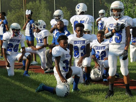 Some Griffin football players took a knee, other stood for the national anthem on Tuesday. All of the coaches took a knee. (Photo: Jordan Culver/ Tallahasee Democrat)