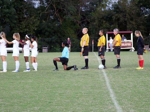 Brebeuf senior Lauren Turner dropped to one knee during the national anthem (Photo: Varsity Views)