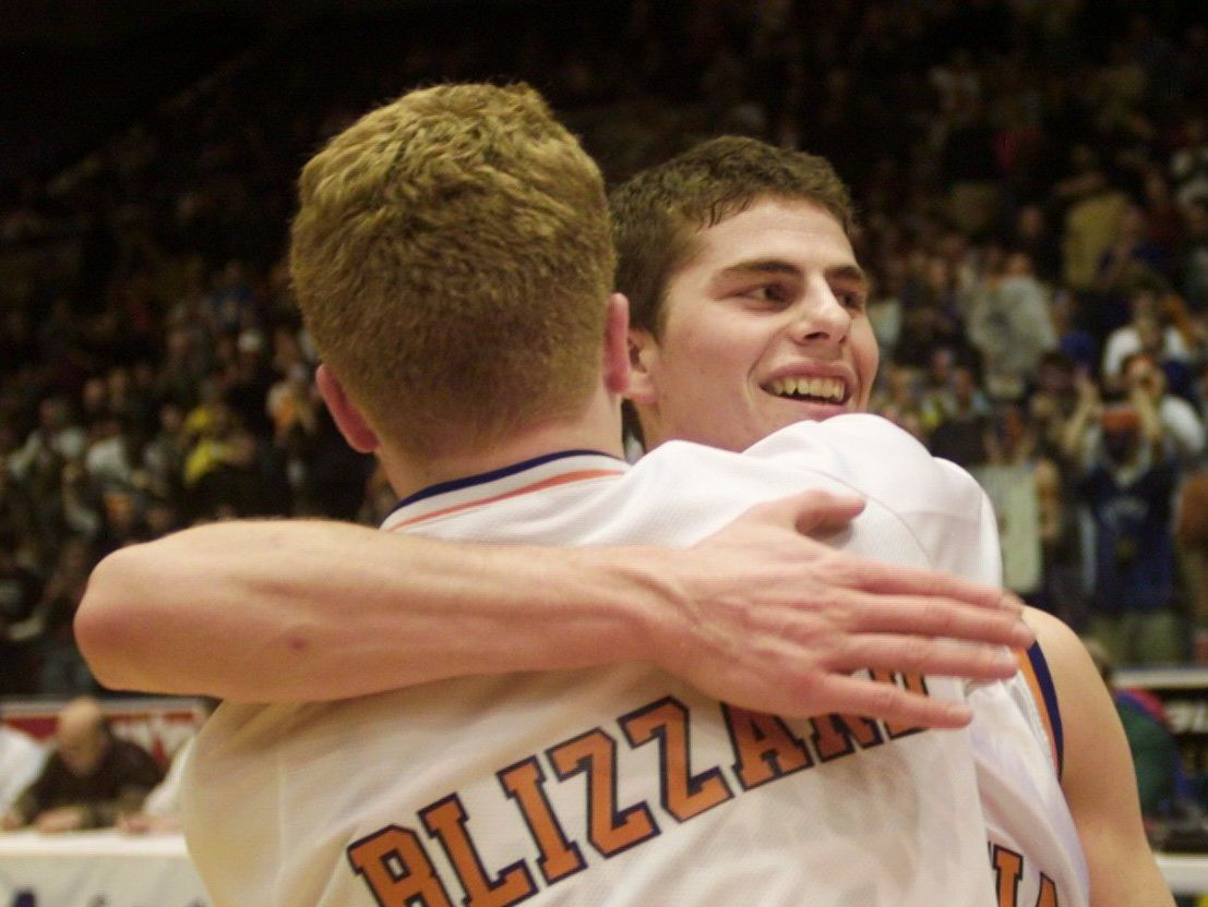 In this 2001 file photo, Kevin Downey celebrates with a teammate after beating Waterloo in the Class B final.