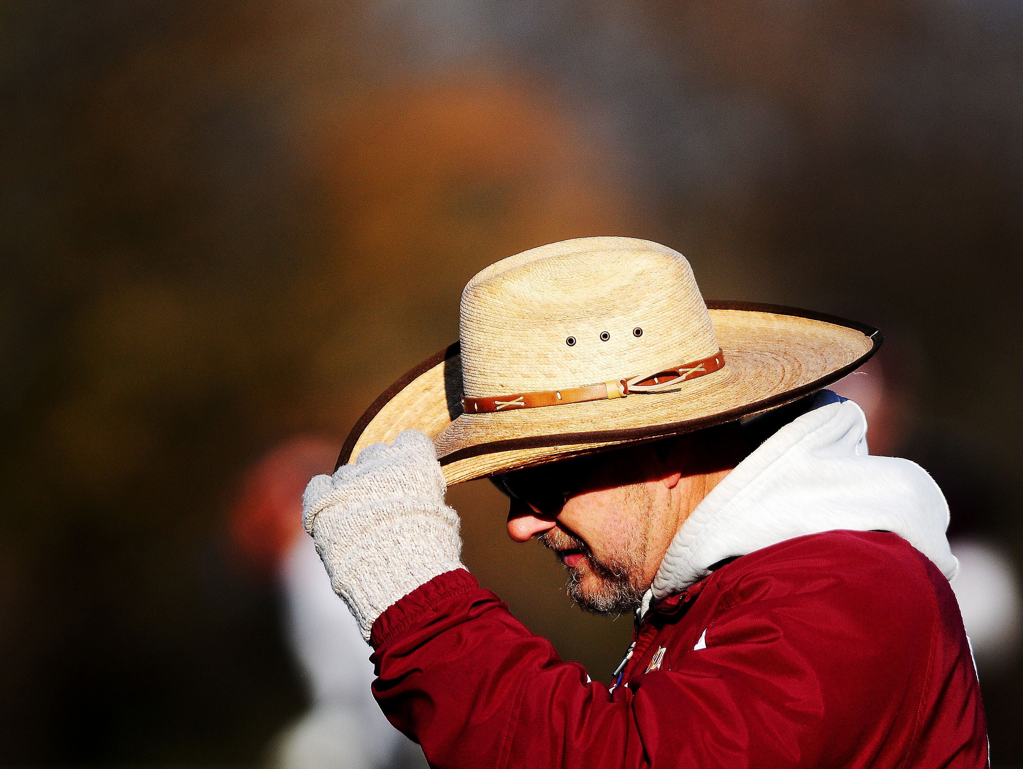 Madison coach Max Hodgen adjusts his hat during a game against Dell Rapids at Trojan Field in Madison, S.D., on Saturday, Nov. 9, 2013. (Joe Ahlquist / Argus Leader)