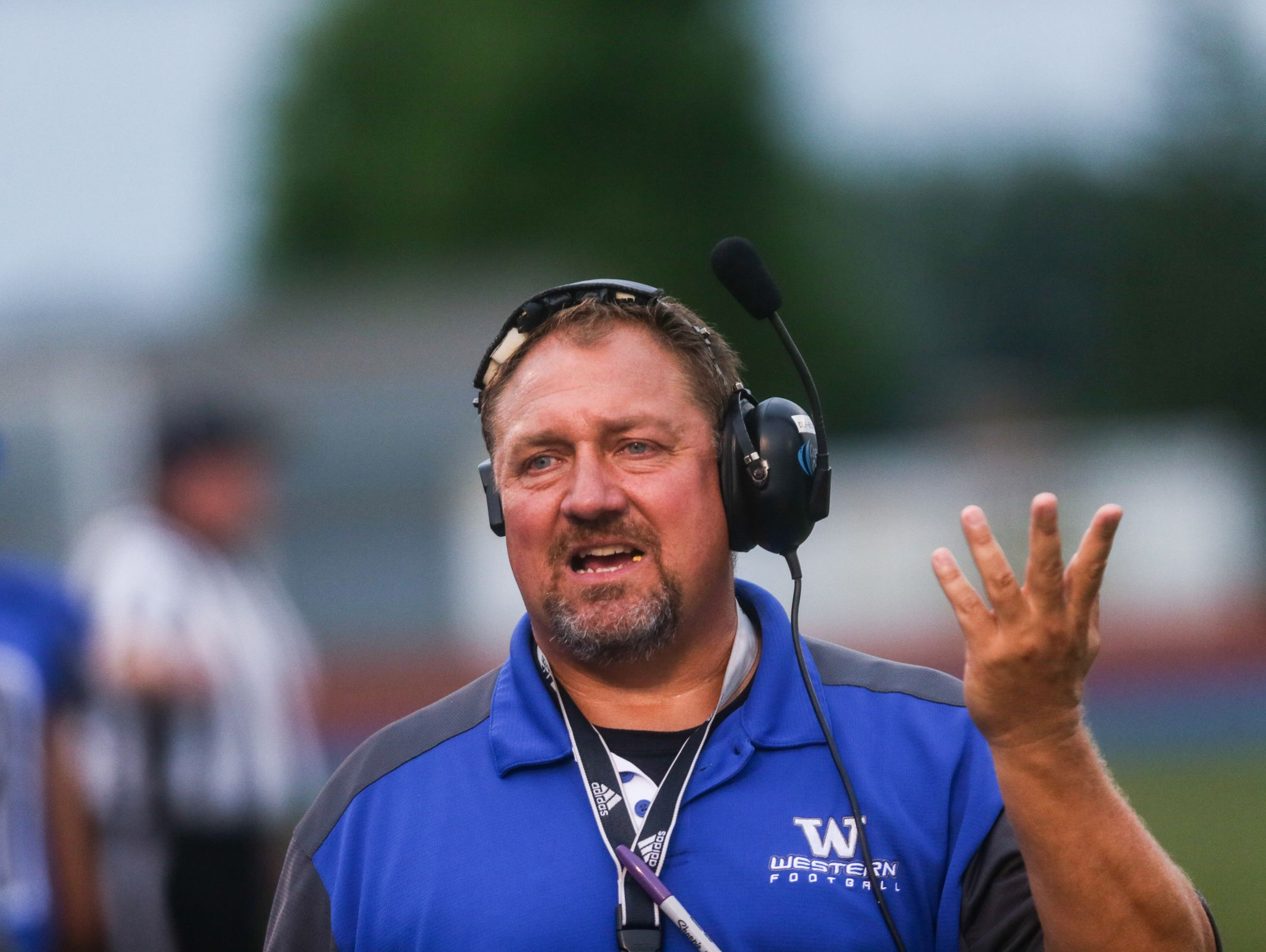 Walled Lake Western's head coach Mike Zdebski on the sideline against Northville on Monday, September 9, 2016, at Warriors Stadium in Walled Lake, MI.