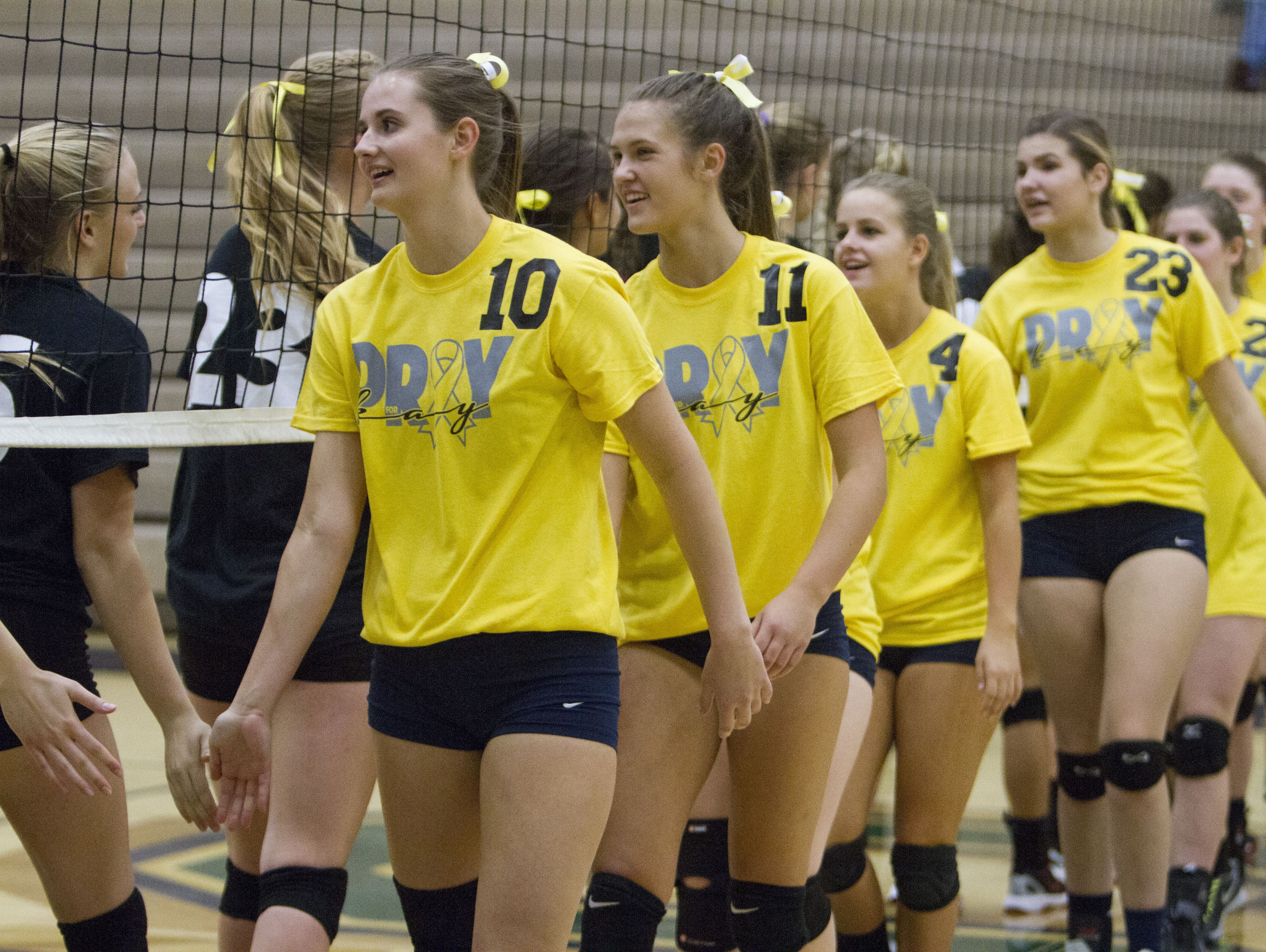 Members of the Snow Canyon High School volleyball team wear yellow shirts in support of Mackayla Marshall, the daughter of Hurricane High volleyball coach Content Marshall and who was recently diagnosed with cancer Thursday, Sept. 22, 2016.