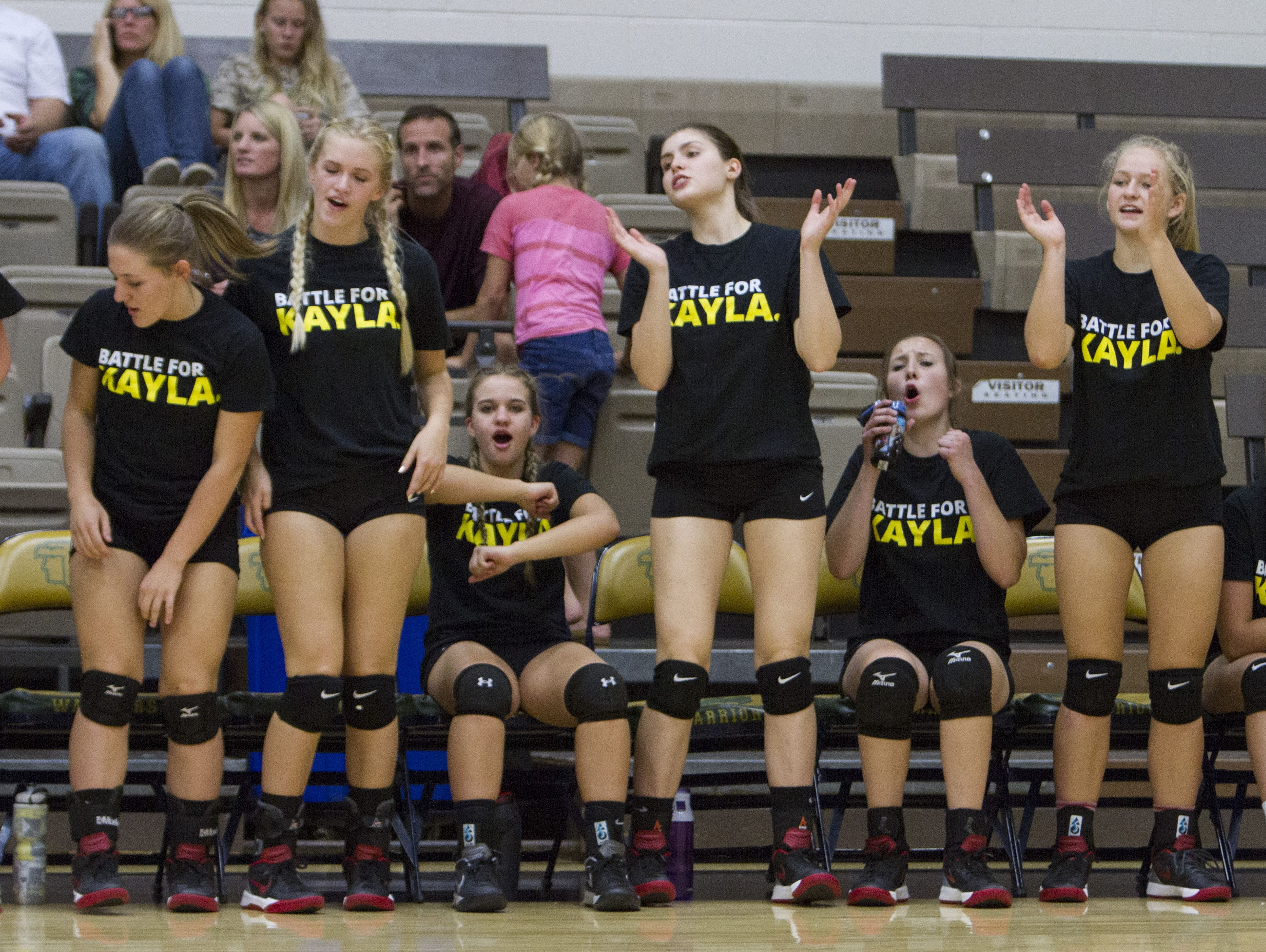 Members of the Hurricane High School volleyball team wear yellow shirts in support of Mackayla Marshall, the daughter of Hurricane High volleyball coach Content Marshall and who was recently diagnosed with cancer Thursday, Sept. 22, 2016.