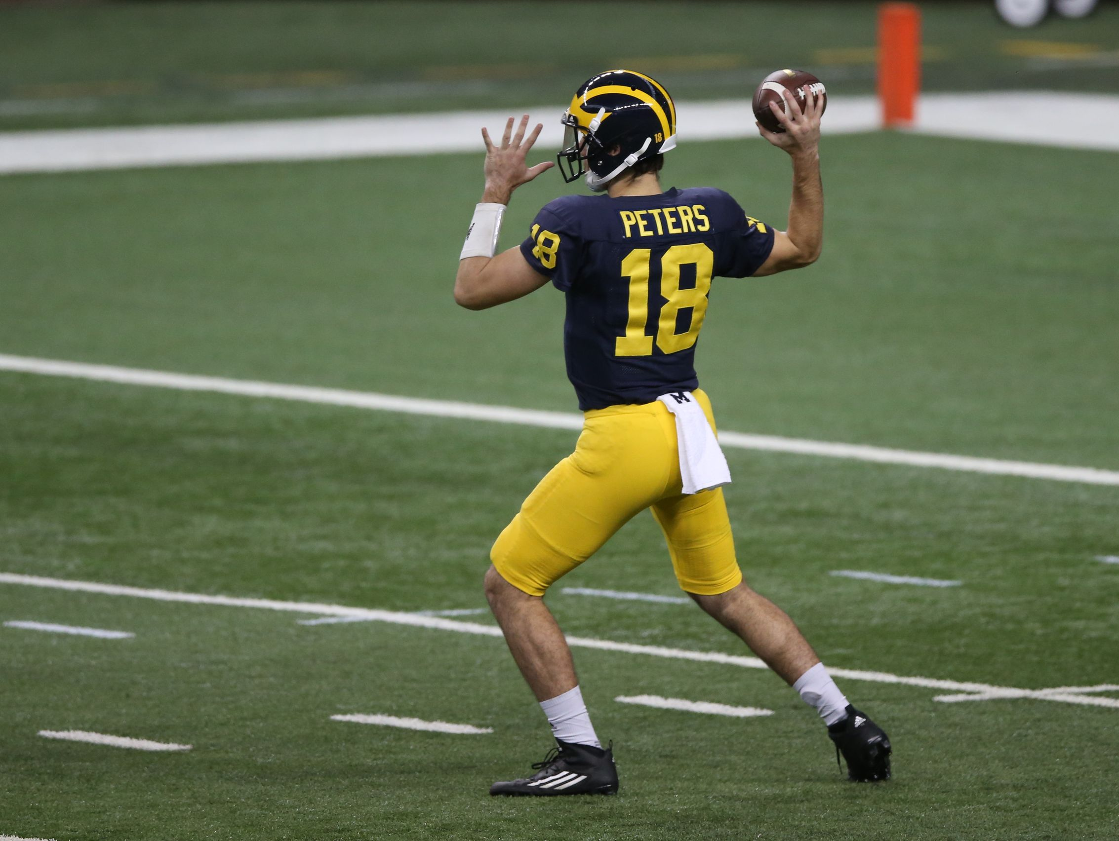 U-M freshman Brandon Peters throws passes during a practice held at Ford Field in Detroit on March 26, 2016.