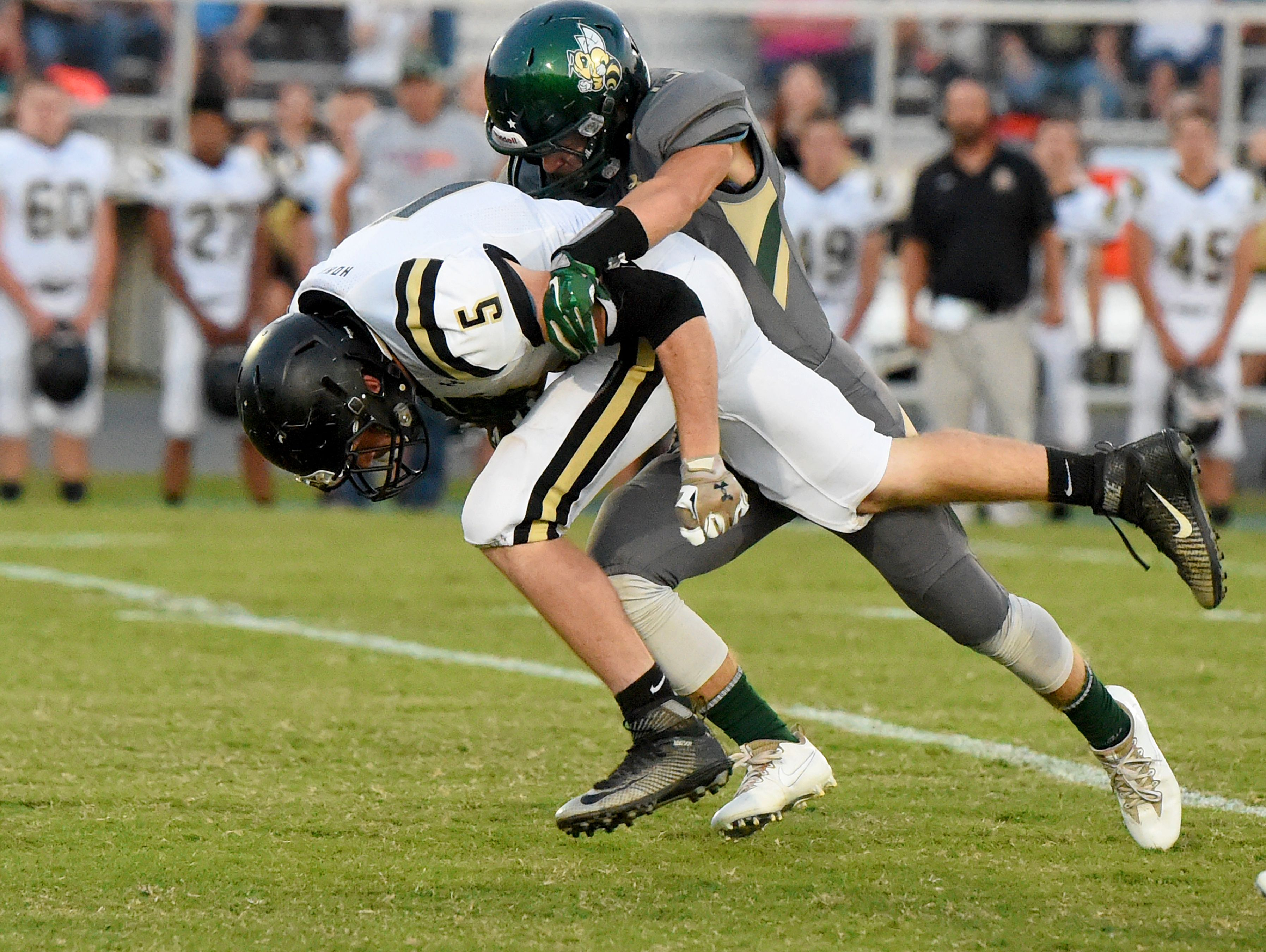 Buffalo Gap's Jacob Thompson is tackled by Wilson Memorial's Michael Via during a football game played in Fishersville on Friday, Sept. 23, 2016.